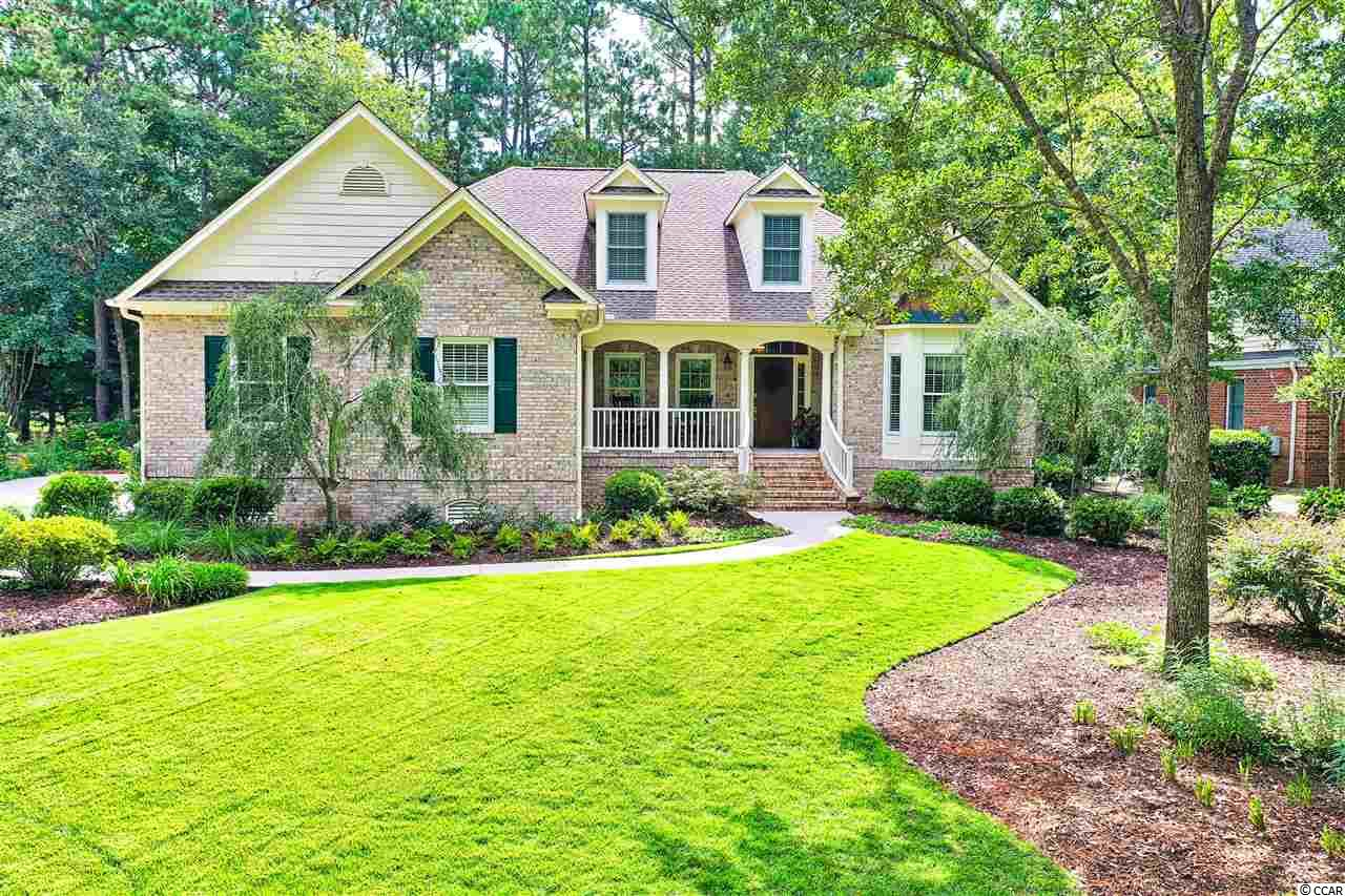 Act quickly as you will not want to miss this beautiful brick custom one-level home featuring 3-bedrooms and 2.5-bathrooms PLUS a Carolina room and study. With over 2,450 heated sq. ft. in the prestigious gated community of Wachesaw Plantation, it surely won't last long!!! As you step inside you will quickly be amazed by the breathtaking open floor plan. The natural light filtering into the great room  makes this space perfect for entertaining or just relaxing by the fireplace. There is a gourmet kitchen featuring high end appliances such as the Sub-Zero refrigerator, custom cabinetry and granite counter tops that provide plenty of space. As you continue through the house, you will find a very impressive master bedroom suite with an oversized walk-in closet. This home has been meticulously maintained by the homeowner and has many upgrades.  The entire home has breathtaking Teak hardwood flooring with tile in the bath and laundry areas. In addition, there is not one, but two hot water heaters, a brand-new HVAC system, and a newer roof that was recently installed. Last but not least, this home also has a massive 3 car garage surrounded by gorgeous gardens! Step outside to a lavishly landscaped and irrigated yard that is situated overlooking one of Wachesaw Plantations nicest greens and you may never want to leave! Wachesaw Plantation is just minutes from the Murrells Inlet Marsh Walk, restaurants, and marinas. It is also a short drive to the live theaters and attractions of Myrtle Beach. Club amenities with membership include golf, tennis, pool, and river view restaurant. Be sure to experience the relaxed lowcountry lifestyle here in Wachesaw Plantation.