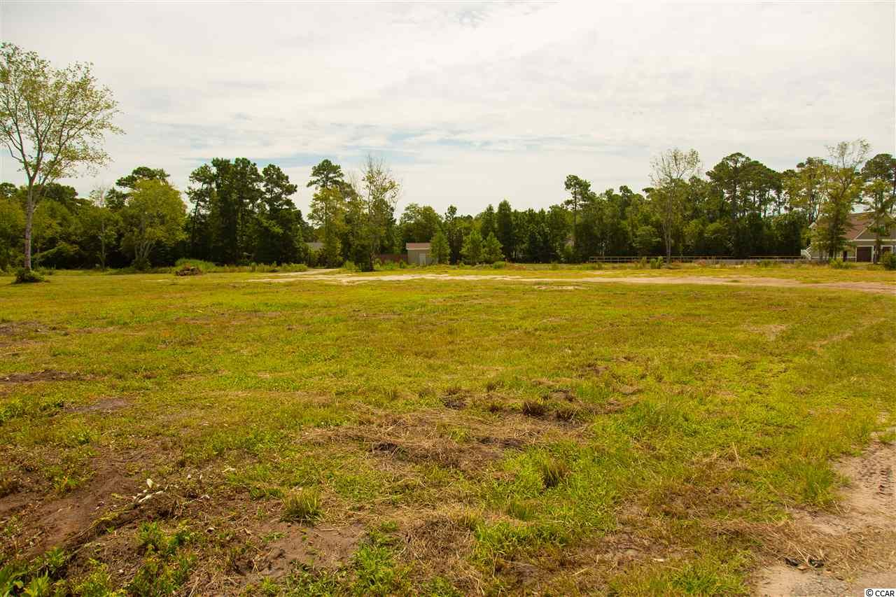 RARE OPPORTUNITY!  Almost 1 acre of land in the Murrells Inlet area.  This is a builder owned lot and the builder will discount the lot if you opt to use them to build your dream home.  Very close to the marshwalk and Garden City Beach.  Walmart is less than 1 mile away.  10 min drive to Litchfield going south or 10 min to Myrtle Beach heading North, this is truly a gem of a lot for size and location!
