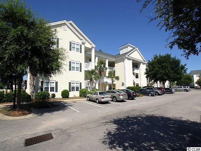 "Beautifully furnished unit that fits most criteria. The view from the screened in balcony is of a large pond with plenty of wild life fowl. gated community, near the beach, nicely furnished, lots of amenities e.g. multiple swimming pools, tennis courts, golf cart parking and close to Main St with clubs, grills and shopping. Access to the beach parking is only one block away. Two entrances to the community. One off Hillside Dr & one off 2nd Ave. Lowes, Walmart Home Depot & many smaller shops are very close by. You'll love the high end furniture and it has only been used as a second home. Ocean Keyes Community has fitness centers, outdoor pools, hot tubs, tennis courts, clubhouse and built-in Bar-B-Que areas and the grounds are beautifully landscaped. Firm price and when you see this you'll agree that it is priced to sell. This one lives up to your expectations. Let's call this one ""A Move In The Right Direction"". BACK ON MARKET!  Don't let it get away again!!!"