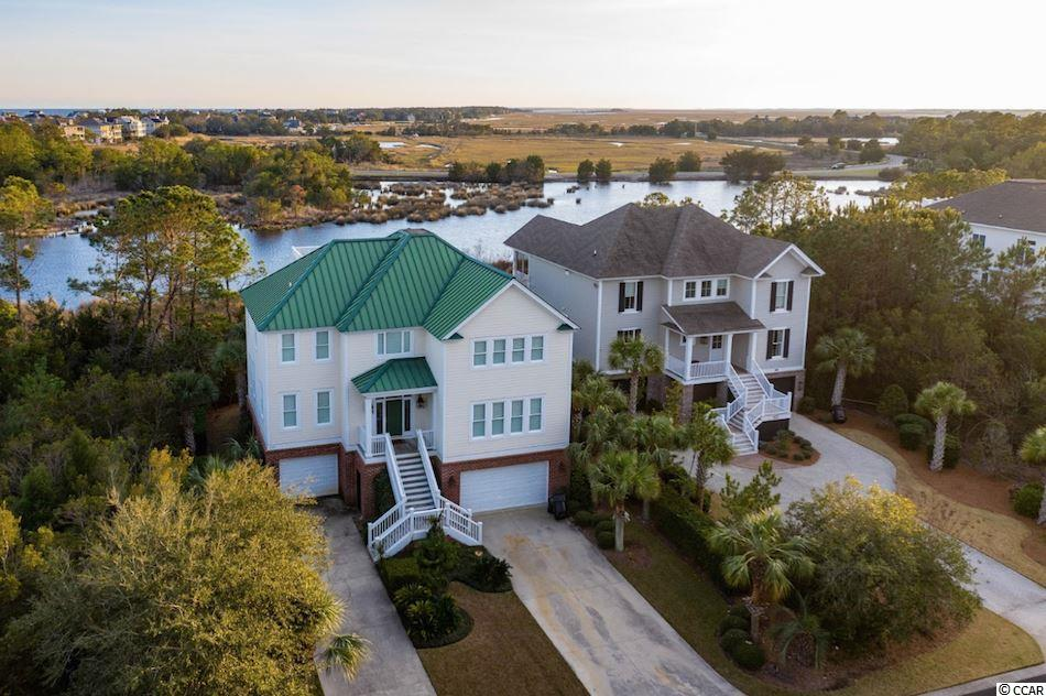 Enjoy easy access to the beach (4 minute golf cart ride!) and capture the beautiful Beach House Pond and North Inlet Estuary marsh views all from 126 Permit Ct. in beautiful DeBordieu Colony.  The magnificent views off of the back porches are unimpeded to North Inlet and will always be that way!  This home has plenty of space for you and yours with 5 bedrooms and 5 ½ baths and provides a turn-key opportunity.  Enter through the front door or elevator on the first level and you will see four very spacious bedrooms and baths as well the large laundry/utility room and additional living area (could be an additional bedroom) for your guests.  Step outside to the screened porch to enjoy just one of the three outdoor living spaces this home provides.  On the second level you will find a great kitchen with breakfast bar seating that is wide open to the dining and living areas.  Enjoy libations from the wet bar adjacent to the kitchen!  The master bedroom and bath complete this level in addition to…another fabulous porch to take in the views.  Head up to the widow's walk above for the maximum view potential.  Complete with plantation shutters throughout and a keen eye for design, you could make this your new beach home today!  Debordieu is a private gated community. Being a member of the Debordieu Club provides members and guests with amenities of golf, tennis, boating, a fitness center, and multiple dining venues. Natural amenities include miles of beach and tidal creeks, walking trails and bike paths, and a delightful year round climate.