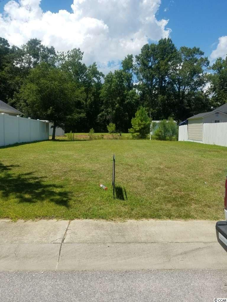 This residential lot is located within .7 mile of the beach and other major attractions of Myrtle Beach!  Nice, quiet dead end street with 12 lots.   Homes require brick front and hardy plank siding.  HOA covers street lights and county road tax fees.