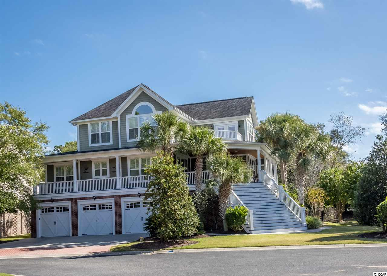 This home has something for everyone! Located in a gated creekfront community in Murrells Inlet. The home features 4 Bedrooms and a half bath with Master on main level. The kitchen has all Stainless Steel appliances along with a gas cooktop with large range hood. Granite countertops plus a wonderful pantry with cabinets and granite.The Living Room boasts a 2 sided fireplace, Hardwood Floors,  Ceiling fan and lots of windows. There is a Formal Dining Room off the Kitchen plus a large Breakfast area for informal family gatherings. The roomy Master Bedroom also has a fireplace, ceiling fan and leads to a large porch with 4 season windows with plenty of privacy. The spacious Master Bath includes a separate tiled shower with awesome shower heads,  Deep jetted tub, and 2 large walkin closets. As you ascend the stairs you will notice the wrought iron pickets on the stairwell. On the top floor you have 3 bedrooms, plus another room that is used as a reading room that opens out onto a deck.  The bedrooms are spacious and have lots of windows. You can then take the elevator down to the ground level and there you will find a large room that has a full bath. This can be used as a game room, mother in law suite or whatever your heart desires. Off of this room is an large enclosed porch with 4 season windows. It has a full kitchen and leads to the backyard patio. Next you will see the garage! It is totally heated and cooled, has a fantastic workshop plus can hold 7 cars! There is also air conditioned closets for storage.  This home also has security system, lawn sprinklers. Belle Vue, the community is a small gated community that sits on the Murrells Inlet creek. If offers a boat ramp, covered dock for the afternoon  gatherings plus a day dock for docking your boat after fishing!