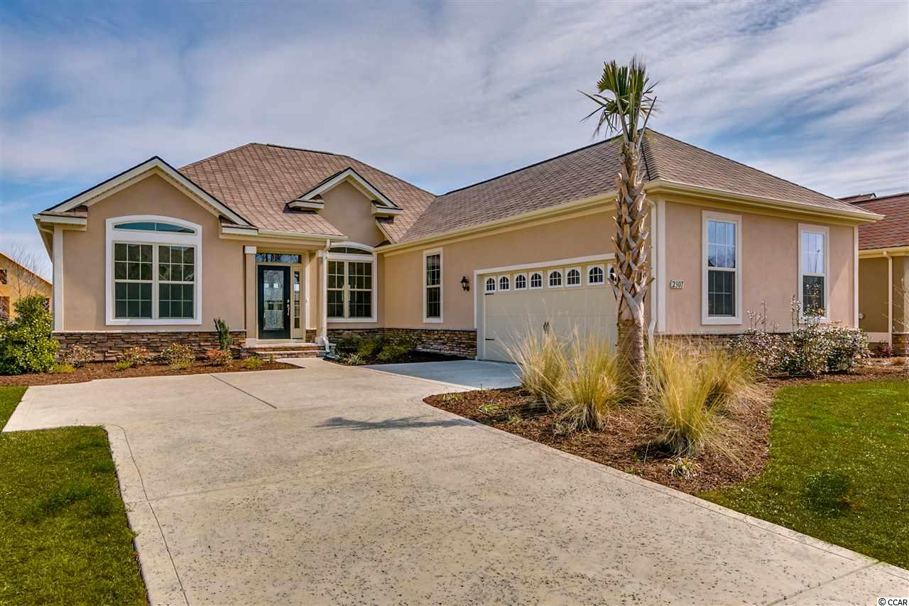 "Tuscan Sands is last new construction single family community in Barefoot. Enjoy resort living life style. The  Hawthorne plan offers spacious and open living areas  3 Bedrooms, sun room and bonus room . Kitchen offers granite counter tops with a sit down island. Home has 3"" hickory natural hardwoods thru out the living area. Carpet in bedrooms and tile in baths and laundry. Master bedroom has tray ceiling and walk in closet. Master bath has 5' tile shower, linen closet, and granite vanity. This home sits on a beautiful lake with great views.  Make this your new home today.  Just 5 minutes to ocean , ICW and Barefoot Landing!"