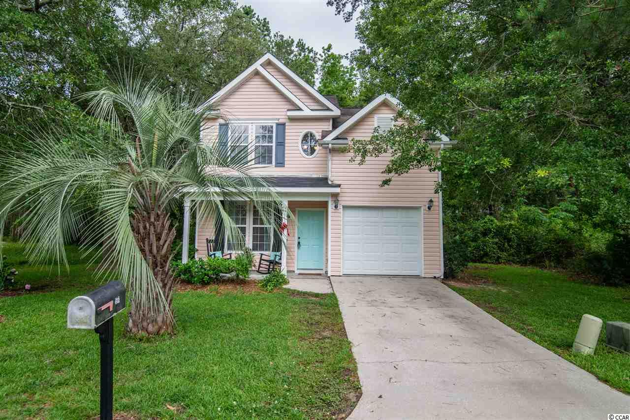 Cute, cute new listing in the Wedgefield Plantation community - 197 Robert Conway Ct. - The Arbors at Wedgefield!  Great room with vaulted ceilings and pretty hardwood floors that continue into the kitchen and the large dining area - great space for entertaining. Brand new carpet upstairs and with three bedrooms, and two and a half baths this home is ready for it's new people.  The upstairs owner's bedroom has vaulted ceilings, bathroom with double sinks, shower, and large walk-in closet.  The two additional bedrooms and bath are also upstairs. There is a downstairs powder room, walk-in attic storage, one car garage, front porch and back grilling patio.   Wedgefield Plantation is an active and beautiful community with it's own public golf course and a boat landing into the Black River.  Enjoy wonderful dining onsite at The Manor House, an easy golf cart ride from home.  Separate memberships available if you so desire - pool, social and golf.  Close to historic downtown Georgetown waterfront Harbor Walk, shopping, wonderful restaurants, fresh seafood vendors, and access to five rivers that surround the area with an easy drive to Pawleys Island, the closest beach access.  *Buyer responsible for verifying square footage.
