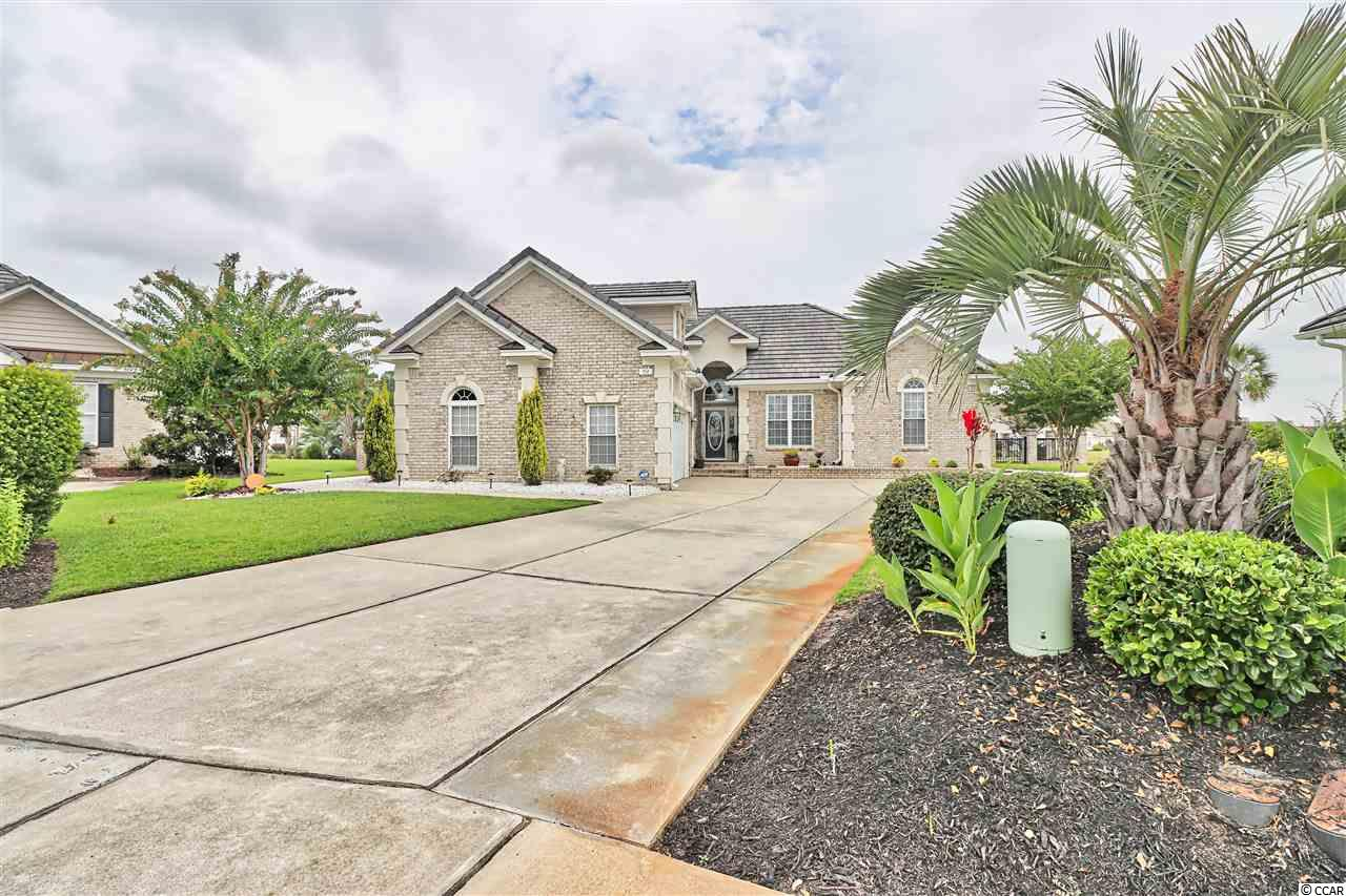 Welcome to the highly sought after gated Lake Forest section of Surfside Beach Club. Conveinently located minutes to shopping and the beach. This home is located on a lake front cut-de-sac with a very private backyard to relax while taking in the views of wildlife and the fountain. This home features an open floor plan, cement tile roof, oversized two car garage.  This home is loaded with upgrades, intercom system, gas fireplace, whirlpool tub in master ensuite, water purifier, double hung windows and bonus room. Call Today!!