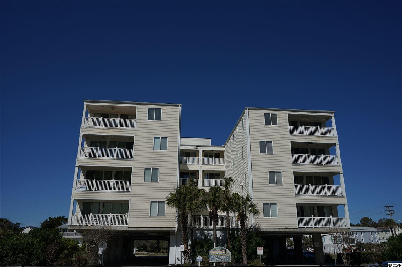 This large 5 bedroom 5 1/2 bath condo is located in the highly sought after Windy Hill Section of North Myrtle Beach.  This end unit comes fully furnished with its own private balcony and another smaller balcony overlooking the complex pool.  This unit has a large breakfast bar in the kitchen with room enough for a large party.  The huge, well equipped kitchen includes stainless steel appliances, granite countertops, new full size refrigerator and freezer.  The master bath has a jacuzzi style tub,  there is a separate laundry room with washer & dryer.  This complex has an elevator for your convenience.  Owners are allowed pets, motorcycle and golf cart.  After a long day at the beach (which is right across the street) you can relax on the large balcony or take a dip in the pool.  Located minutes away from Barefoot Landing, great shopping, restaurants, golf and much more.  This great condo can be your second family vacation spot or can be a great rental producer.