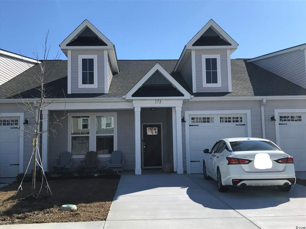 Take in the ocean breeze living in this single level Villa located in Bridgewater!  The Topsail features 2 bedrooms and 2 full bathrooms with an open kitchen, dining and great room. Beautiful fireplace and tray ceiling in the Great Room. Master Bath has a 5 foot walk in tile shower with seat.  Gas range inKkitchen! With over 1400 heated sq. ft. this coastal-living home features both a master suite and an additional bedroom all on one level. Enter The Topsail from your covered front porch or your one car garage. Easily entertain or host large gatherings with an open living and kitchen area. A large Island offers additional seating. Whatever your needs may be, this interior model with ceiling is the home for you! Open relaxing rooms offer plenty of space for you to experience the natural beauty of coastal living.