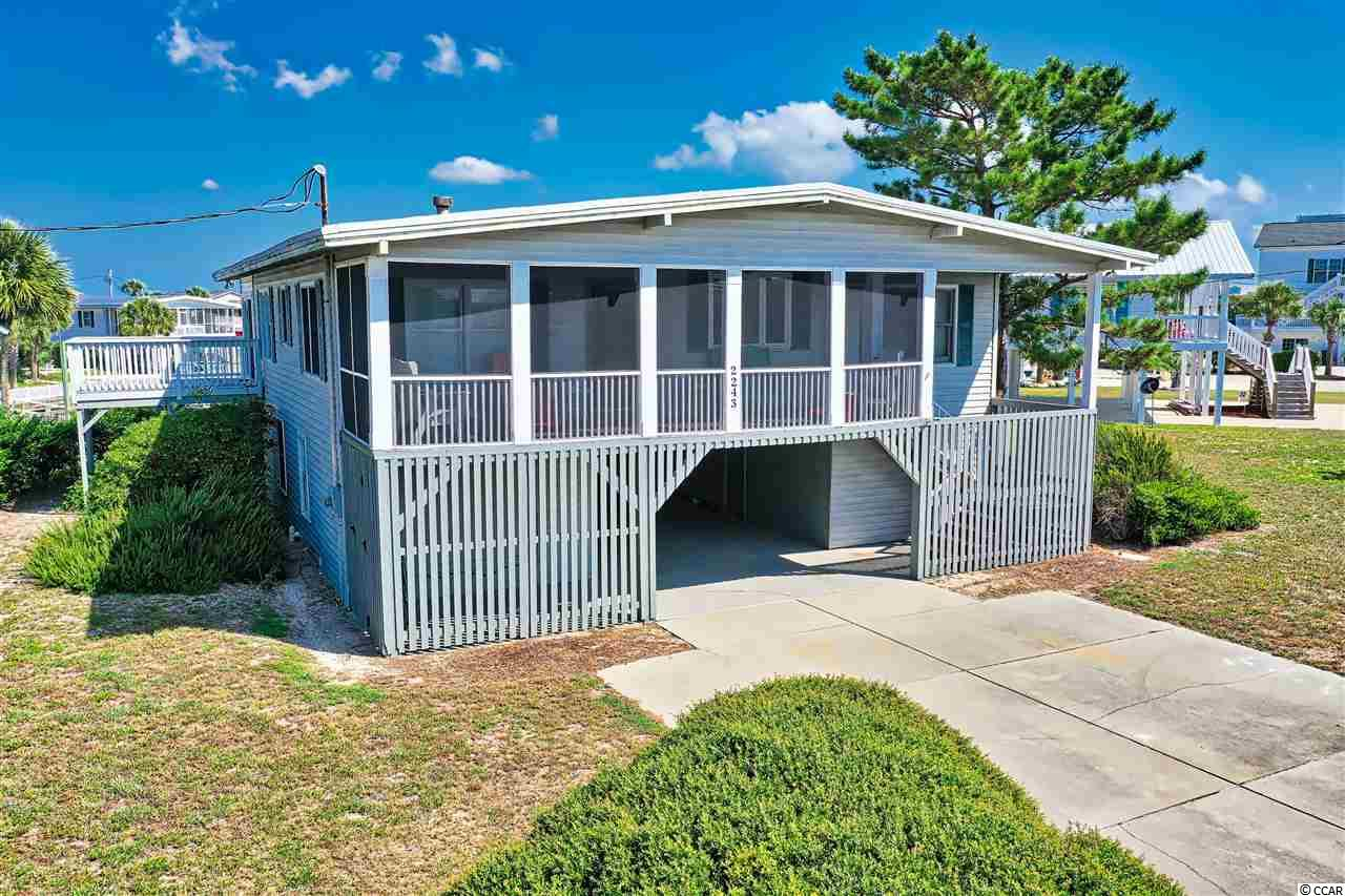 Imagine a lifestyle where your choices are a stroll on the beach, drinks on the screened front porch, or boarding a boat from your private floating dock. Nestled on a cul-de-sac directly on a channel leading to Murrells Inlet and the Atlantic Ocean, enjoy the homey features of this classic raised beach home located on the Garden City Peninsula.  The ground floor features what could be a in-law suite with two bedrooms separated by a full bath as well as a large den room with a washer and dryer. Plenty of covered areas for parking the golf cart, bikes and a boat. An outdoor shower on the this level is so convenient for rinsing away the salt and sand before heading upstairs. The upstairs porch has been redone with composite decking and newly screened. Enter and enjoy the open concept of kitchen, dining and family room in one large living space with gorgeous hard wood floors throughout. With four bedrooms on this level you will love the layout of two bedrooms and one bath on either side of the living space.  The vaulted, beamed ceilings and a propane fireplace give a cozy feel to the home and create a relaxing vibe.  The Carolina / Sun room is off the family room with access to one of the bedrooms and is light filled with an expanse of brand new windows with Levelor blinds.  Enjoy a great view of the yard and the boats from a large side deck accessed by a new sliding door and another new sliding door leads down to the ground level.  This has been a 2nd home for the same family for almost three decades and is ready for the next generation of memories. Great location, just south of Marlin Quay Marina and Gulfstream Cafe.