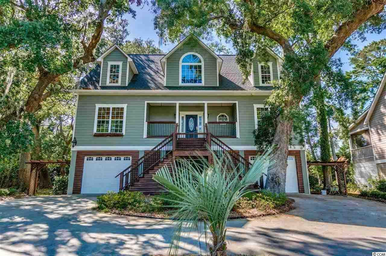 Exceptional 4 BR / 4 1/2  BA raised beach home in the desirable Marsh Point neighborhood, a great location with a community dock to enjoy!! Nature meets comfortable luxury in this well cared for beach-style home. Lots of windows give this home natural light throughout. Beautiful hardwood floors throughout main level. Unique quality handiwork throughout, including mother in law suite, large screened in porch, huge back deck for family and friends gatherings, beautiful granite, tile flooring in all the bathrooms, shaft built in for an elevator if you would like to have one installed, stainless steel appliances and more. Separate work room area a Plus! Huge Master bedroom with plenty of natural light here as well. Master Bathroom has beautiful ceramic tile flooring which surrounds the oval whirlpool tub and shelving to hold all your décor. Convenient location  East of 17 business close to everything in Pawleys Island and Litchfield. Whether you are looking for a primary home or second home for those trips to the beach, you have to see this home!!  You bring the family I'll bring the friends and we can all have a great time in YOUR NEW HOME!!