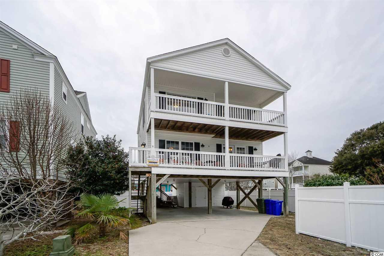 Awesome raised beach home in the heart of Surfside Beach!  Large front porch with multiple rocking chairs for those summer breezes.  Home has 4 bedrooms, 3 full baths, private pool, and much more.  Public access just across the street from the house, so you can easily walk or carry your chairs to the beach.  Owner just replaced stairs and reinforced decking this year.  Located only 7 blocks to Surfside Pier and not far from Garden City Pier. Storage room on ground level can hold your golf cart! House is sold fully furnished except some personal items.  Come see this wonderful family beach house today!