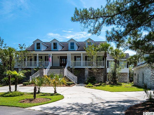 Start your day with a cup of coffee while enjoying the scenic waterfront view of historic ricefields, marshland and wildlife from the privacy of your back porch. This spacious two story Lowcountry style home was designed to capture the beauty of nature from almost every room in the home. From the moment you walk through the front door the inviting open floor plan filled with natural light makes for the perfect living space.  The master bedroom offers space for a sitting area with breathtaking views and private access outside to the  back porch. The spacious master bathroom features a large jetted tub and walk in closet. Downstairs you will find an in-law suite, home theater, and bowling lane. Entertain your friends and family with an evening of bowling and movies from your in home theater and bowling alley.  You're just a short boat ride to the Intracoastal Waterway (ICW) where you can enjoy the day on the water and dine at one of the local waterfront restaurants located in the historic seaport city of Georgetown! !This home is located in the admired golf course community of Wedgefield Plantation.