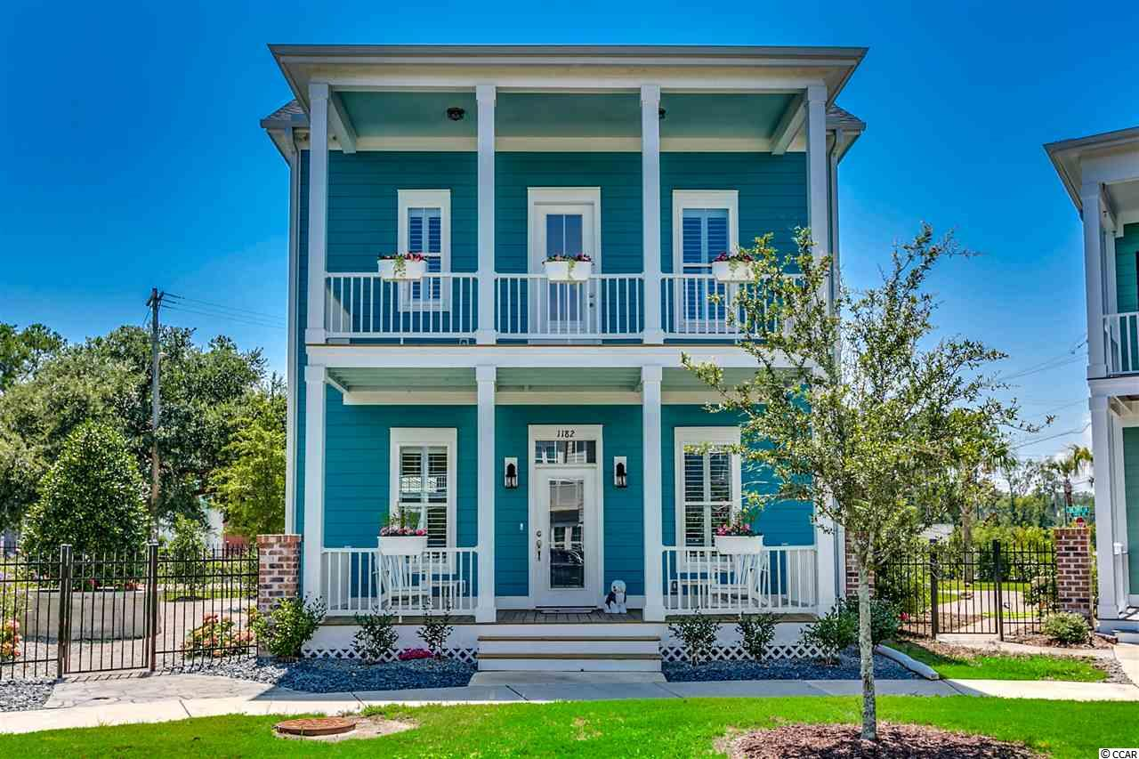 Welcome to this Charleston style community called Sweetgrass Square West in Market Common. This beautiful home offers multi tiered decks,  private  driveway behind home to accommodate 4 cars, and finished courtyard with Mega-Arbel patio slab. This Watercolor floor plan features generous first floor living space on the first floor and three bedrooms on the second floor. Kitchen offers granite counters, beautiful cabnetry, gas cooking and stainless appliances. The first floor features hand scraped wood flooring and carpet on 2nd floor. The open design floor plan allows you to entertain and enjoy your guests. Dining area offers wainscoting and shadow boxing. Half Bath is located behind the kitchen. Step out the back door to your very own spacious courtyard to garden and entertain. The Master Bedroom is spacious on the 2nd level and features access to a 22' x 8' deck with peaceful views. Master Bath is gorgeous with walk in tiled shower, large soaking tub, double vanity with granite counters, linen closet and commode closet. Laundry room is conveniently located on the 2nd floor and has a water line for a future utility sink or coffee bar. Crowning this gorgeous home are the lovely plantation shutters. Walk to the shops and restaurants at Market Common or stroll down to the Myrtle Beach Culinary Institute for lunch. The beach is a short golf cart drive and the Myrtle Beach Int'l Airport is less than 10 minutes away. Start living the easy Market Common life style and relax!!