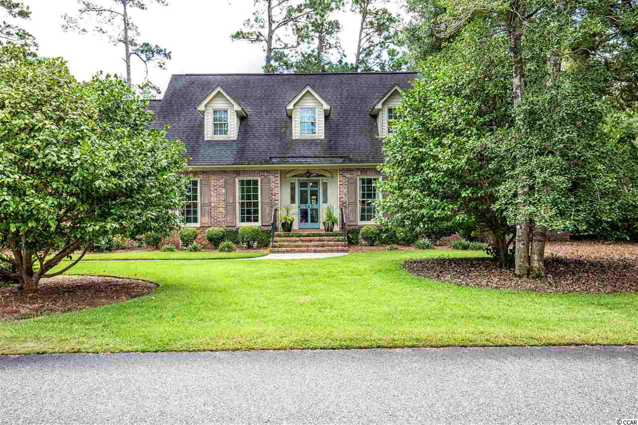 Charming, 4 Bedroom, 4 Bath home on a large corner lot in the desirable Mt. Gilead community. This classic neighborhood is tucked away under the Live Oaks in the quiet town of Murrells Inlet. This One of a kind, custom built home features a Low Country inspired design with a traditional layout that will make you feel right at home. The formal dining room and living room are located right off the foyer, giving an elegant focal point upon entry. The bright and beautiful kitchen is open to the dining room and has many upgrades that include-granite countertops, stand alone island/breakfast bar, built in cook top, stainless steel appliances, double oven, wine cooler, crisp white cabinetry, and a spacious breakfast nook. Quality hardwood flooring and custom finishes throughout. Relaxing family room with fireplace and additional space for seating and entertaining guest in the den. The first floor master bedroom has a large en-suite bathroom with double sinks, stand alone glass enclosed shower, and a huge walk-in closet. The additional 3 Bedrooms and 2 Full Baths are located upstairs along with a huge Bonus room that could double as a 5th Bedroom. New HVAC and New Tankless water Heater. Don't miss out on this stunning home, located in a prime location, east of highway 17 business, close to local shops, restaurants, Garden City Pier, and the Murrells Inlet Marshwalk.