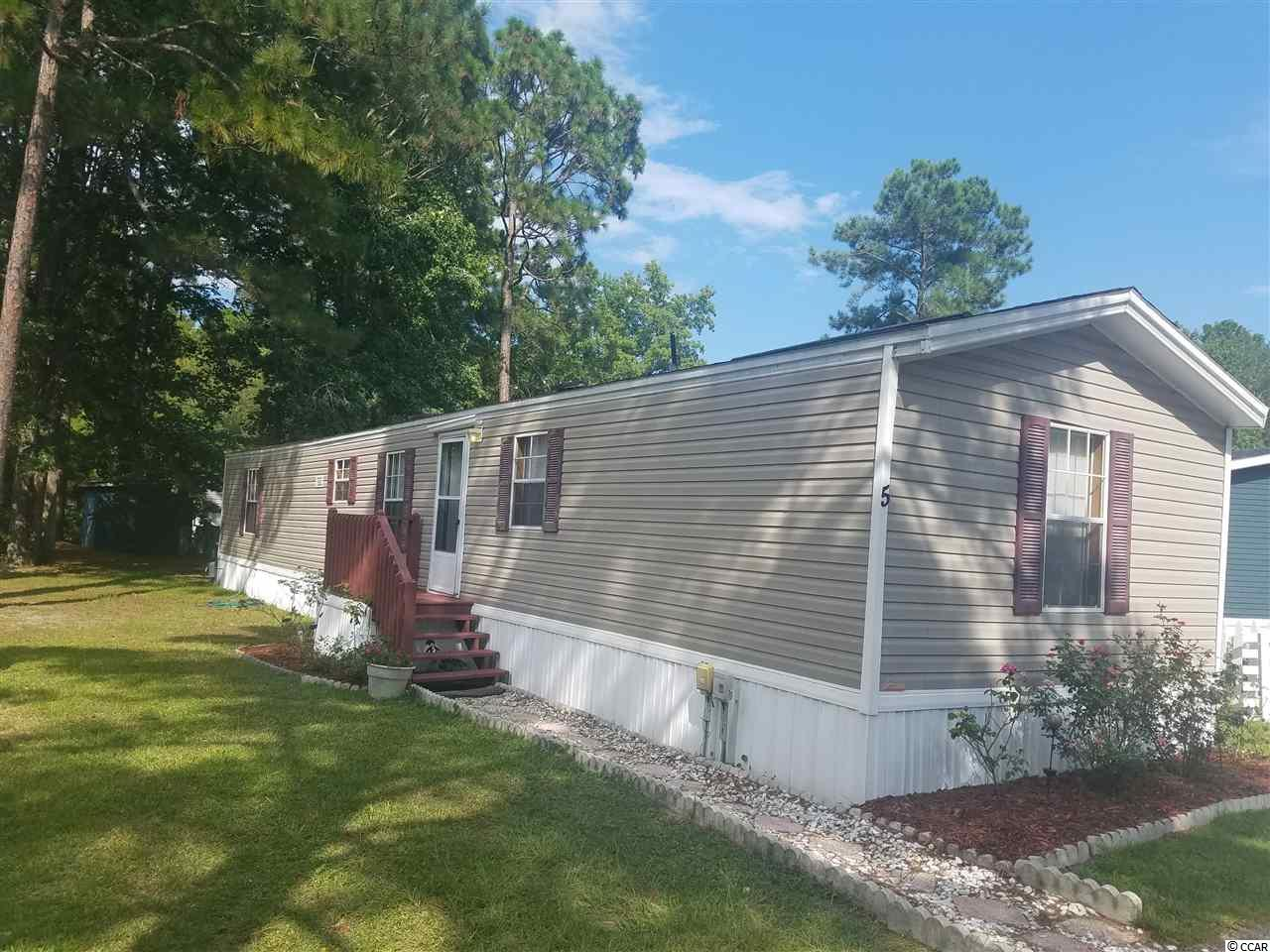 Beach living in Windjammer Village which offers a pool, community clubhouse along with basketball court and boat storage.Very well kept home, nice and clean. Close to everything Myrtle Beach has to offer. A 10 minute ride to the beach. Golf carts are welcomed here.