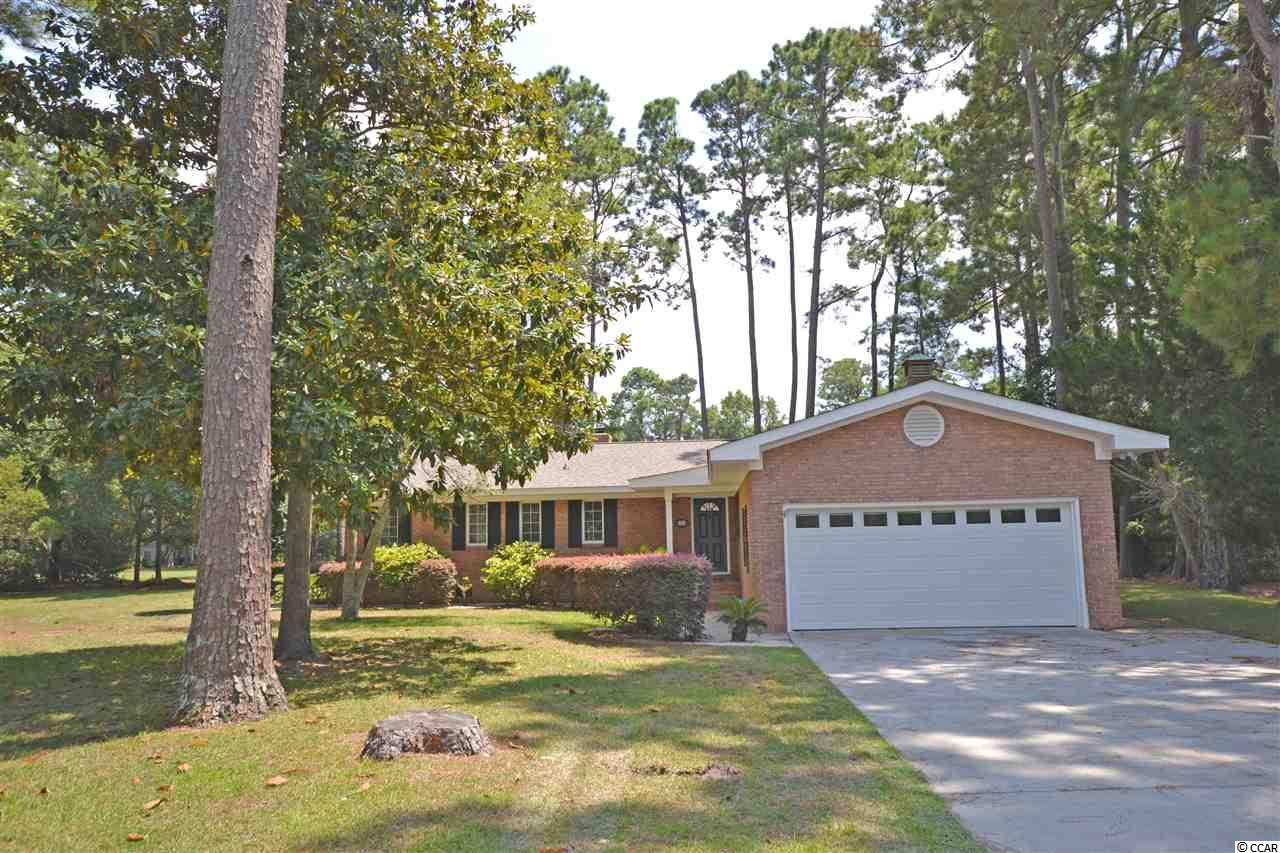 Welcome to 35 Bay Tree Place, a cozy 3 bed/2.5 bath brick home located on the 8th fairway of Litchfield Country Club!  Updated home with brand NEW HVAC and roof in 2019!  This one story house has a spacious open den with windows exposing a patio looking out to the golf course for enjoying morning coffee in your rocking chair or outdoor evening meals with plenty of room for friends.  The kitchen has been updated to include marble countertops and stainless appliances.  It  has plenty of cabinet storage and a breakfast nook.  The master suite has a dressing table adjacent to the closet.  This home has an attached garage, a Carolina Room (that can easily be used as and office) and a wood-burning fireplace.  Conveniently located in Litchfield Country Club off of Country Club Drive.   Only a few minutes to Litchfield's beautiful beaches and close to boutique shopping and fine dining.  Litchfield is just a 70 mile drive to historic Charleston, SC or 25 miles to the attractions of Myrtle Beach.