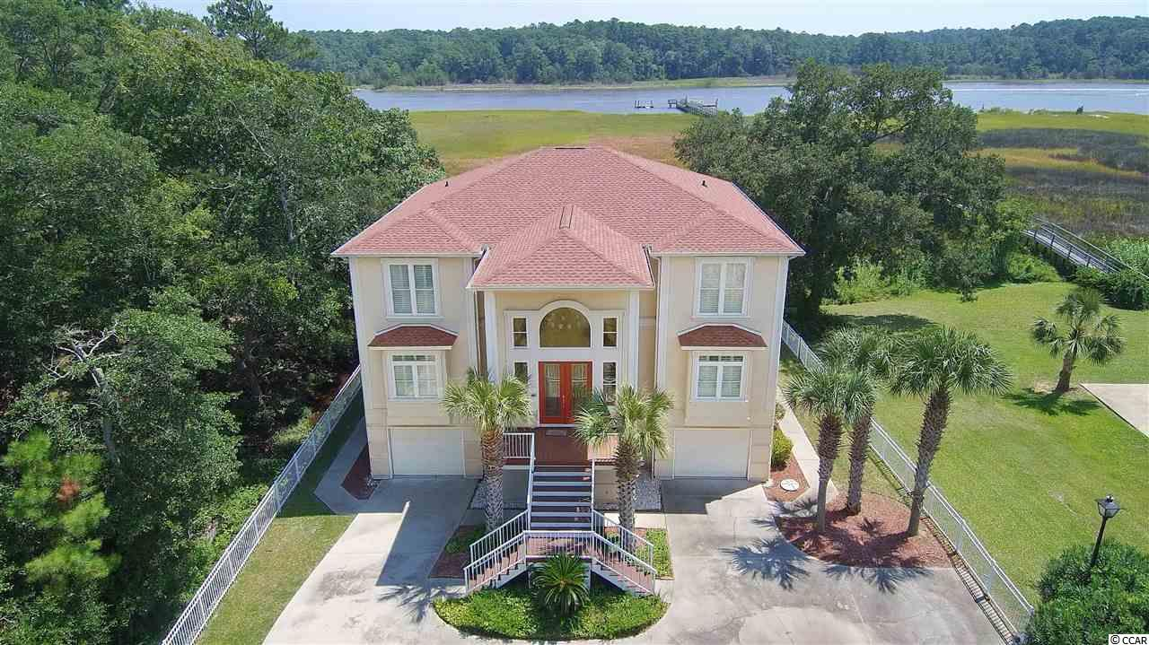 Watch the sunrise while sipping coffee from this exceptional home in Little River on the Intracoastal Waterway!  Located in a tranquil setting with stunning views of the ICW and marsh, this 5 bedroom home boasts a spacious living area with floor to ceiling windows and coffered ceiling; gourmet kitchen with granite, stainless steel appliances, work island, and large walk-in pantry; Master suite with amenity filled bath, including oversized walk-in shower, whirlpool tub, dual sinks with granite tops, and extensive closet space; hardwood, tile, and carpeted floors throughout; large family room on 2nd level with wet bar overlooking Waterway; recreational room on ground level with wet bar and half bath overlooking Waterway; 4 additional bedrooms, two of which overlook the ICW; elevator, privacy fence, large decks, screened porch off of Master, security system and surround sound capability, large dual garages, abundant storage, extensive trim detail, and much more!  New carpet in bedrooms and freshly painted in 2017.  New doors leading to decks in upstairs bedrooms in 2017.  Several new light fixtures and all new LED lights (26) around the outside of the housein 2017.  New roof in 2018 with a 50 year warranty and 10 year warranty on workmanship.  Shared pier and dock in place.  Extraordinary home and opportunity! Measurements are approximate and not guaranteed.  Verification should be made by buyer.