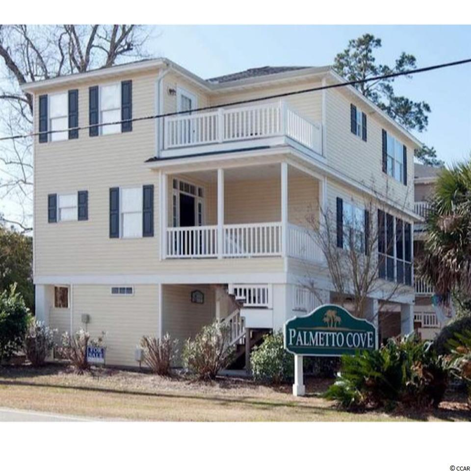 This raised beach home is being sold fully furnished.  East of Business 17 in the town of Surfside Beach. Short golf cart ride to the beach.  Beautiful kitchen cabinets with granite counter tops.  Three bedrooms each with a full bath and a half bath located off the living room.  A formal dining room with a porch directly off the dining room.  Hardwood floors, outdoor shower and a community pool.  This home looks practically new and is full of sunlight.