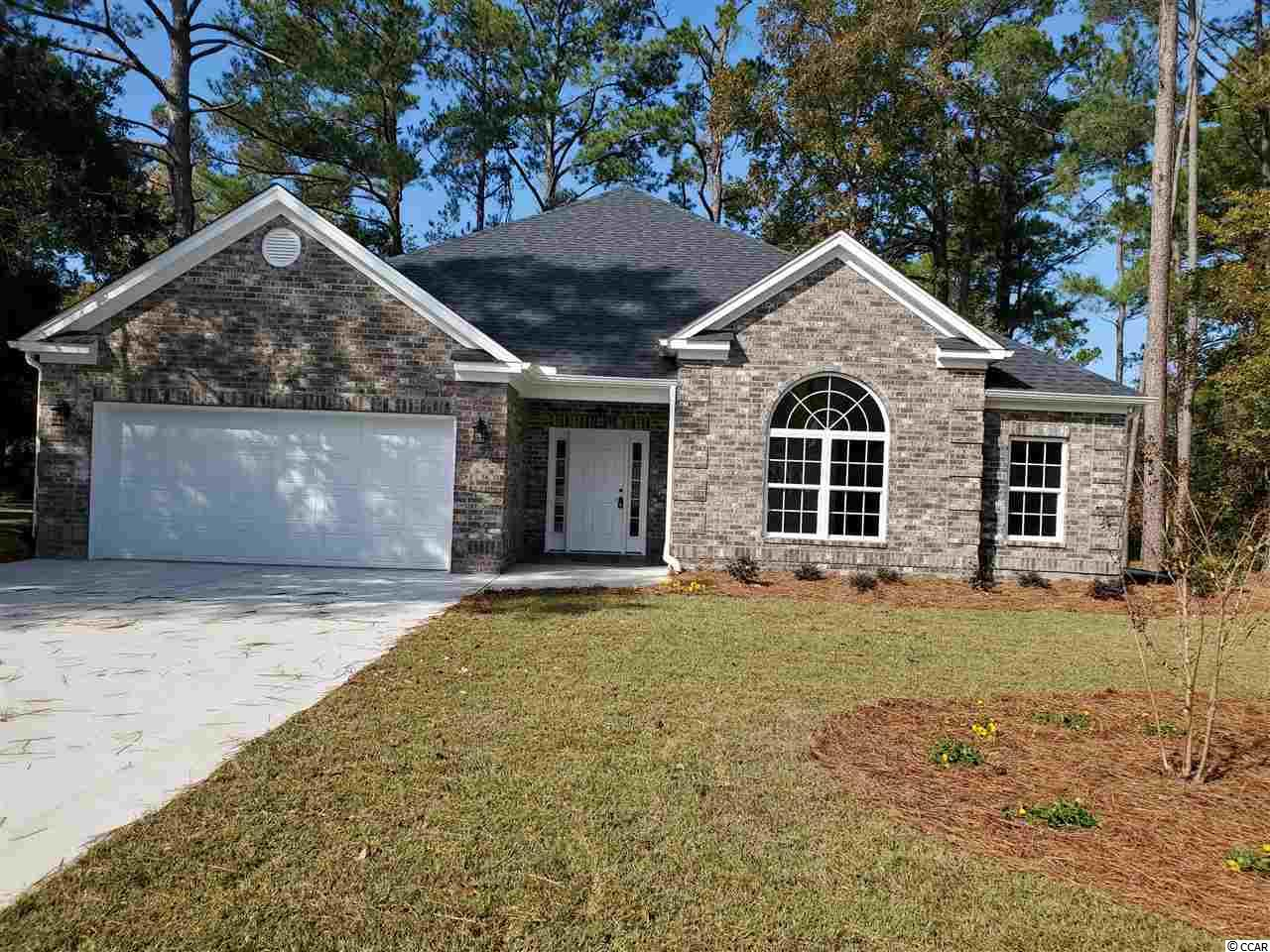 All Brick Custom home with lots of upgrades. Granite counters, stainless appliances, 7x10 pantry, custom tiled shower, vinyl plank flooring throughout with tile flooring in baths, upgraded lighting package. Two ceiling fans on screened back porch. Irrigation system and upgraded landscaping package that includes gardenias, azaleas, crepe myrtles, loropetalum,hydrangeas,ginger lilies, lantana,amaryllis bulbs and much more.  Bayfield is located off of Wachesaw Road and is not in a HOA. You can park your boat or RV here. It is halfway between the Intracoastal Waterway and Murrells Inlet Creek.