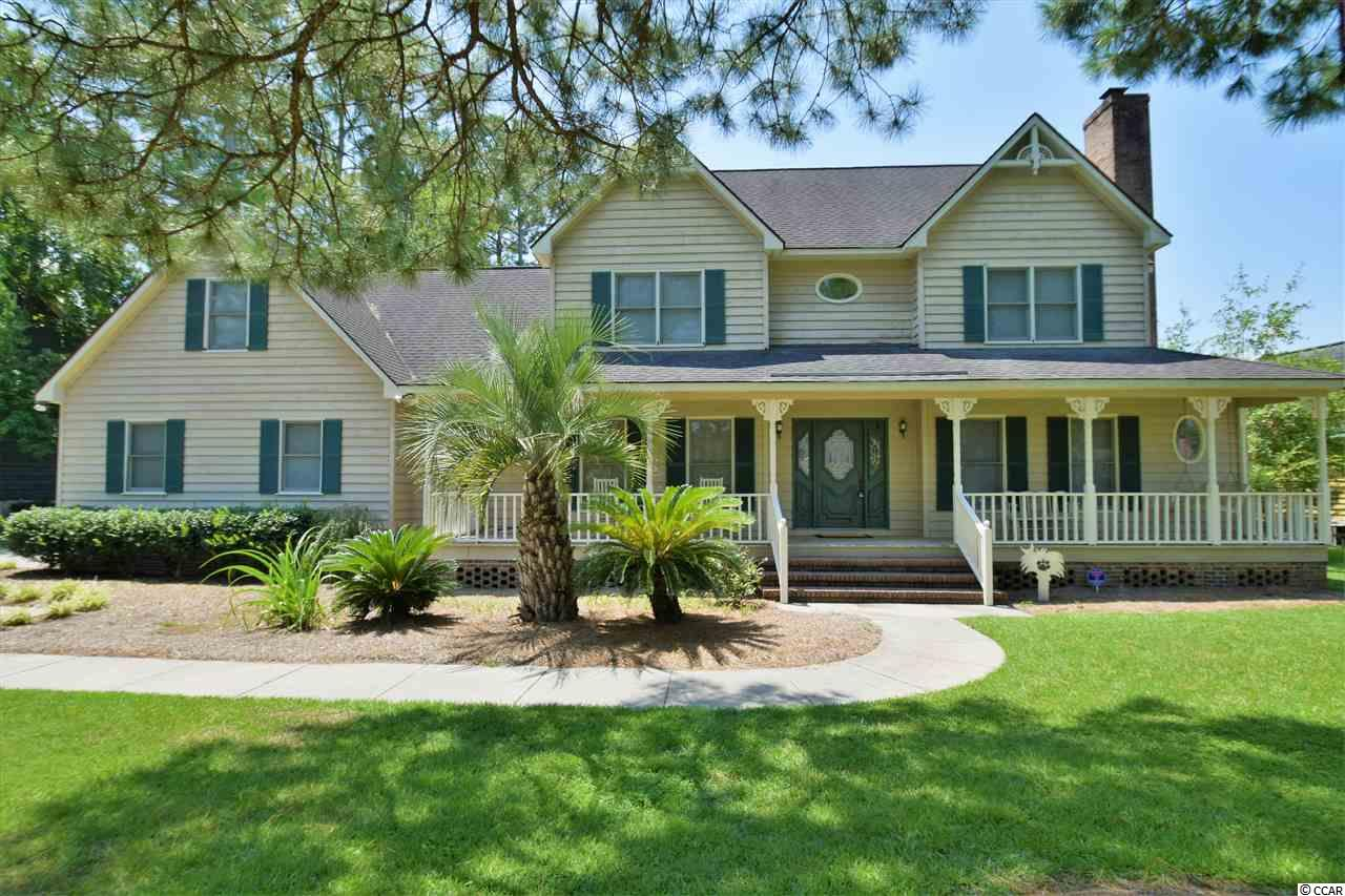 Low Country home located on a pond in the highly sought after Forest Lake Estates. This house has 5 Bedrooms, 3 Bath, an Office, a Bonus Room, and a Carolina Room.  The interior and exterior has been freshly painted.  Plenty of closets and storage space throughout the house.  Enjoy your time relaxing on the large front porch or entertaining on the back deck overlooking the pond with beautiful sunsets.  On the first floor you will find the living room with a wood burning fireplace, formal dining room, large kitchen with tall cabinets, a breakfast nook and island, the Carolina room, a full bathroom, the laundry room, 2 bedrooms and the office.  Up the stairs is the master bedroom with 2 closets,  the master bathroom with stand up shower and Jacuzzi Tub, 2 more bedrooms, bathroom #3, the bonus room, and attic storage.  The large driveway allows you to park 4 cars and still enter the side load 2 car garage easily.  This house is a must see!  Square footage is approximate and not guaranteed, buyer is responsible for verification.