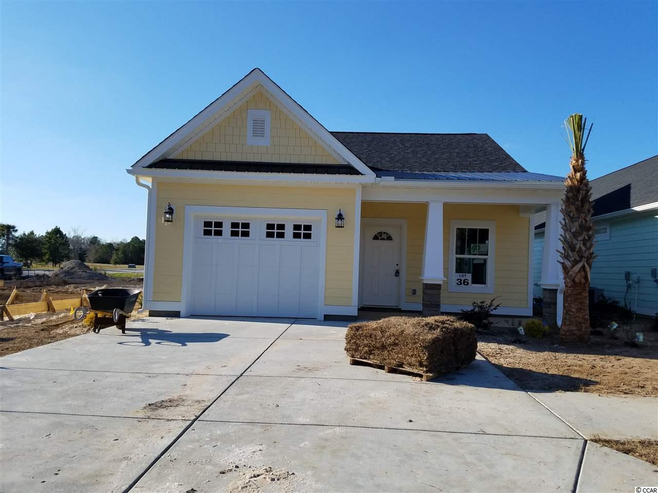COLORFUL, CHARMING & CUSTOM BUILT!! For those seeking the best of both worlds, discover the historical quaint town of Conway located 20 miles of the beach and excitement. Discover why Carsen's Ferry is the perfect fit for you and your family. Located just off 501 behind a scenic lake, this master planned community features attractive well-lit streets and sidewalks, beautifully designed streetscapes with lush landscaping. This park like setting is ideal for early morning jogs or afternoon strolls. These finely detailed, Low Country Cottage has a gas range, on demand gas hot water, gas heat, brick accents, bright coastal color palettes,and front porches perfect for that fine old lost art of visiting with neighbors.