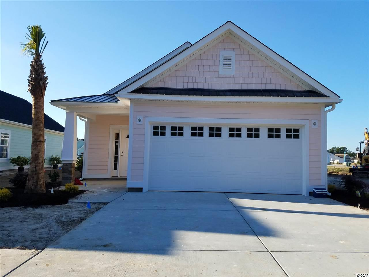 COLORFUL, CHARMING & CUSTOM BUILT !! For those seeking the best of both worlds, discover the historical quaint town of Conway located 20 miles of the beach and excitement. Discover why Carsen's Ferry is the perfect fit for you and your family. Located just off 501 behind a scenic lake, this master planned community features attractive well-lit streets and sidewalks, beautifully designed streetscapes with lush landscaping. This park like setting is ideal for early morning jogs or afternoon strolls. These finely detailed, Low Country Cottage has a gas range, on demand gas hot water, gas heat, brick accents, bright coastal color palettes,and front porches perfect for that fine old lost art of visiting with neighbors.