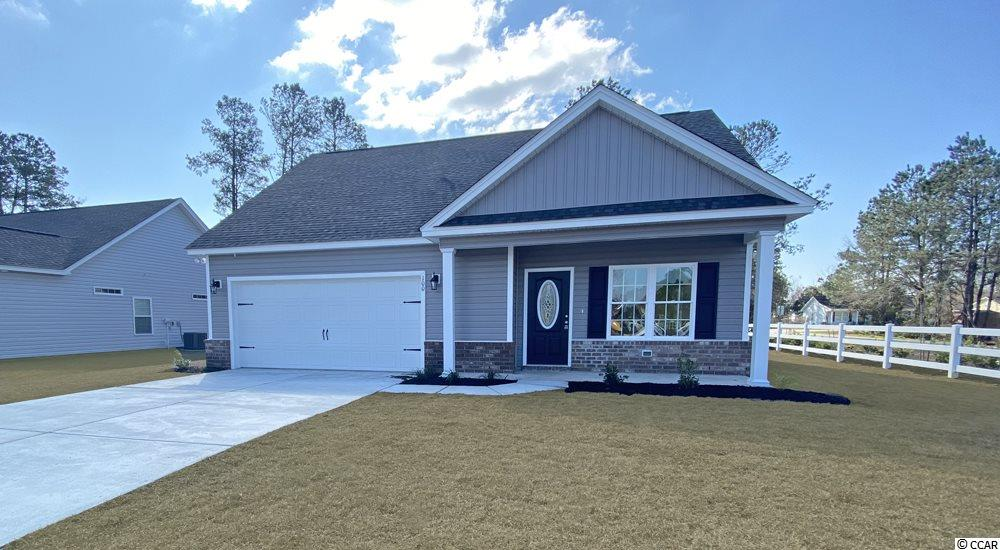 Beautiful Tybee floor plan in the new Ocean Palms community. Purchase early and choose all of your own colors!.  This terrific 3 bedroom, two and one-half bath, open floor plan home will come standard with vinyl flooring in the family room, kitchen and dining area and comfortable carpet in the bedrooms. Stainless appliances, staggered-height birch cabinetry, a large pantry and a convenient breakfast bar combine to give the kitchen the wow factor you're looking for, and the abundant recessed lighting and slider, leading to a large concrete patio, in the adjacent dining area floods the room with light.  The spacious master retreat is on the first floor and features an oversized walk-in shower, plenty of storage in the cabinetry and linen closet, plus a walk-in closet. Two additional bedrooms and a bath are on the second floor. All of the homes in Ocean Palms come standard with the luxury of natural gas (tankless water heater, gas heat and a gas range). The garage is completely trimmed and painted, with floored attic space accessed by drop-down stairs. Ocean Palms is conveniently located near shopping, restaurants, schools and world class medical offices and hospitals, and a short golf cart ride to Surfside Beach's gorgeous beach and the Atlantic Ocean. Other floor plans and inventory homes may be available, and CUSTOMIZATION OF FLOOR PLANS IS POSSIBLE!!! Community pool and cabana coming soon! Photos are of a completed, similar home and may have different features.
