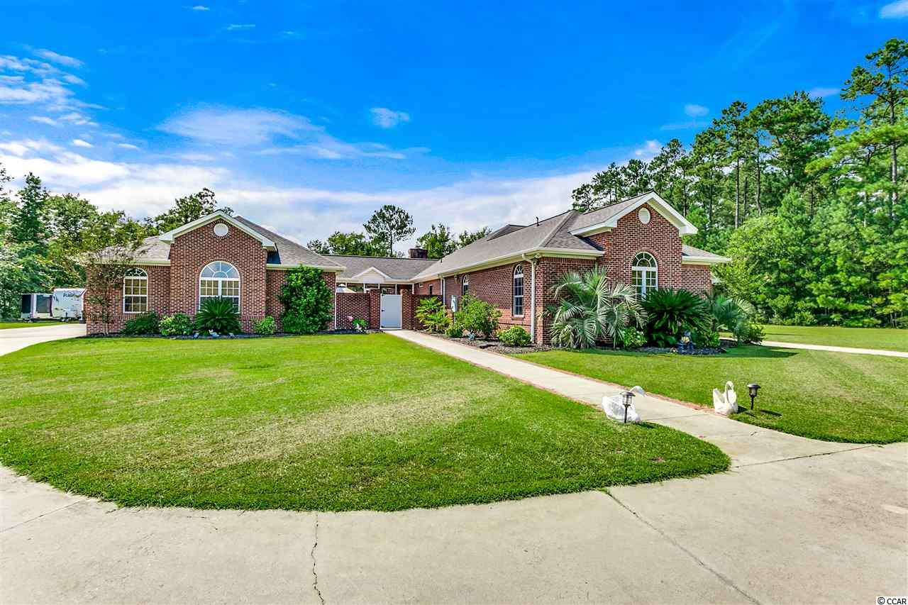 """Custom built on 1.50 acres! NO HOA!  Aynor Schools!  This home has it ALL!  All brick, 4 bed 4 bath with a 4 car garage, 16x24 in ground pool, hot tub, screened porch, courtyard, outdoor speaker system, vinyl fencing, security system and lots of privacy.  Inside you will find upgrades to die for, hardwood and tile floors, 28x23 game room with terracotta brick pavers, office with built-ins that can also be used for a 4th bedroom, large kitchen with 48"""" cherry cabinets, pull out drawers and all new stainless steel applicnaces, silestone countertops, new tankless hotwater heater, and much more.  You will have your choice of rooms for entertaining, a den area with gas fireplace, living area, sun room or the game room.  The 12ft ceilings show off the true craftsmanship.  The 4 car garage is heated and cooled with a workshop and full bath.  This is a must see!  You are only minutes for the beach, shopping, dinning and downtown Conway."""