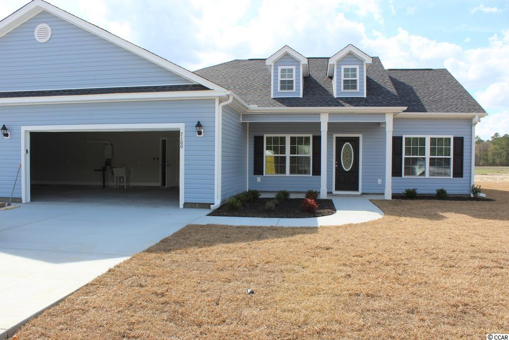 Oak Grove is a new small community just off Hwy 378 in Conway. Large 1/2 acre lots. No HOA fee. This great floor plan, Hickory B4, has a low country covered front porch and rear screened porch, large great room has vaulted ceiling with fan/light, and formal dining room with tray ceiling. Kitchen has custom built wood cabinets with knobs and crown molding, stainless steel appliances including a gas range, breakfast counter/bar, pantry closet and breakfast nook. Master bedroom suite has vaulted ceiling, ceiling fan, huge walk-in closet, double sink vanity, garden tub and a separate walk-in shower. Upgraded wood look waterproof laminate flooring thru-out and carpet in the bedrooms and closets. Rannai tankless gas water heater. Natural gas. Our homes are built with a minimum 9' smooth ceilings, 30 year architectural roof shingles, sodded yard includes irrigation system, fully finished and painted garages with mop sink, automatic door opener and pull down stairs to attic storage plus gutters. Blinds installed on the windows and glass sliding door. This home has an additional 3rd bay added to the double garage with a solid service door. Can park your RV or Boat at your house. Just 30 minutes away from Myrtle Beach and all the fun, food and entertainment you expect. Photos are for illustrative purposes only and may be of similar house built elsewhere. Square footage is approximate and not guaranteed. Buyer is responsible for verification.