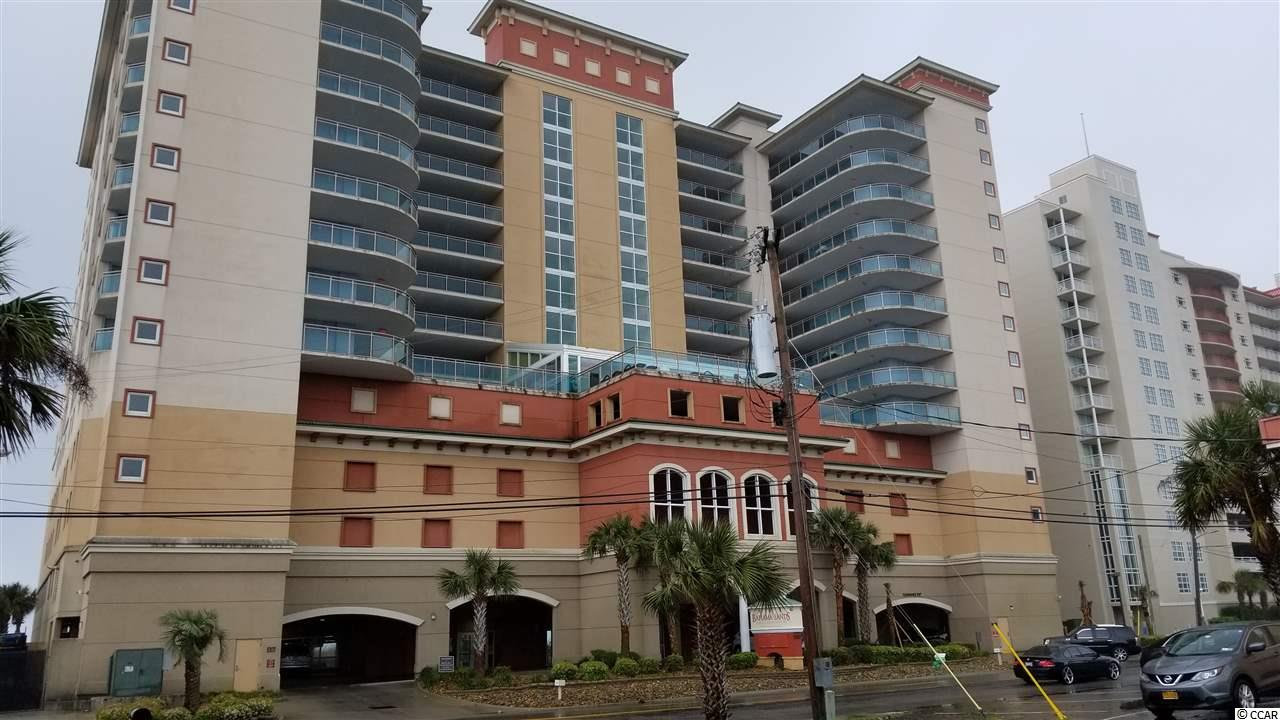 Luxurious OCEANFRONT 3-bedroom, 3-bath condo in North Myrtle Beach.  The ocean view meets your eye as you first enter!  The kitchen, with granite counter tops and breakfast bar, overlooks the family room and an unobstructed ocean view!  Each bedroom has a private bath en suite.  The master suite is off the family room and affords an ocean view, whether still in bed or from its own balcony!  The master bath includes a double vanity and a jetted tub.  All furniture and furnishings convey!  No need to find a laundromat, a washer and dryer are conveniently located in the condo.  When not at the ocean, the hot tub, the lazy river, or the outdoor infinity pool, plenty of seating awaits you at the indoor pool and sunning decks on the 5th floor. Tired of walking the beach?  Try the fitness room for indoor exercise. Located in Crescent Beach area where you are mere minutes from shopping, dining, golfing, medical facilities ~ you name it, it's right around the corner!  Owner is allowed a pet.  Reservations to be honored by buyer will be provided upon request.  All measurements are approximate; buyer responsible for verification.