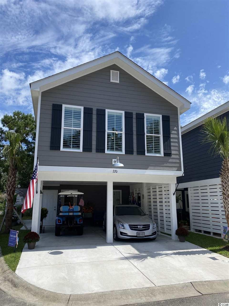 Although only one mile from the Garden City Pier with a golf cart path the entire trip, this home is nestled in a quaint 30 home community with excellent amenities such as a swimming pool and more! This home features Granite countertops in the kitchen, undermount SS sink, GE appliance package with side by side counter depth fridge, ice maker and water dispenser. The white subway tile backsplash accentuates the quality of the kitchen!  Bathrooms include Carrera Marble solid surface countertops with undermount sinks, shiplap walls and comfort height toilet in the master.   Cathedral ceilings in the master bedroom give an open and spacious feel to this home. These ceilings are extended throughout the kitchen into the living room, adding a greater sense of space. To keep the coastal cottage feeling throughout, the living room is accented with a shiplap wall. What really makes this feel authentic is the laminate flooring wall to wall; except wet areas where 18x18 modern tile adorns the floor.   There are far too many upgrades to include in this description so contact your realtor or myself to schedule a showing!