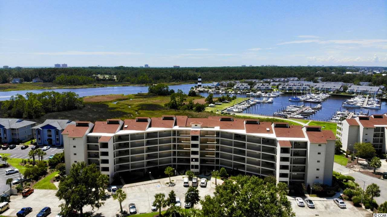 "Captivating views from the moment you walk in this stunning 2BD/2BA waterfront home. Open, spacious and full of natural light overlooking the ICW, marina and lighthouse. Relax and enjoy the coastal lifestyle from the enormous patio perfect for entertaining family and friends. A dream come true for boat lovers, this condo comes with a 42"" boat slip.  Easy access to ICW and ocean. Ceramic tile throughout the home, upgraded kitchen includes new cabinets with quartz countertops and stainless steel appliances. Master bedroom shares the amazing views. Guest bedroom offers flexibility with a Murphy Bed with built in features allowing work space for office, craft room or bedroom. Closets have been professionally designed for optimal storage. This ICW community offers pool, clubhouse and convenience to dining, entertainment and area beaches.  Square footage is approximate and not guaranteed.  Buyer is responsible for verification."