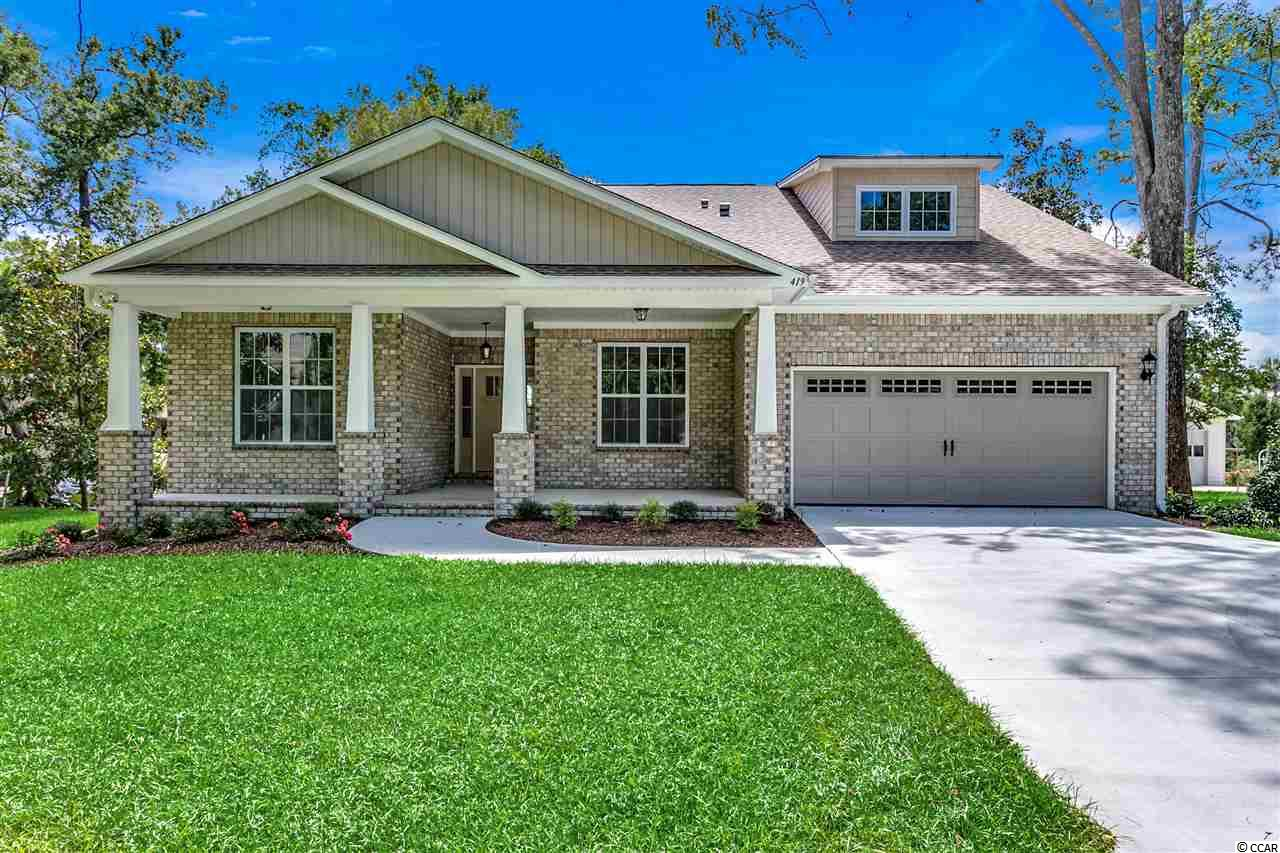 Beautiful new 3 bedroom, 2 bath home with large (15x19) Bonus Room and walk-in attic on lake Dogwood in Surfside Beach with panoramic views. Built by Bill Clark Homes. Never occupied. Large Master Bedroom on ground level. Master bath with large walk-in shower & double sinks. Sprinklers on 9 zones. Beyond landscaped area in back yard where grass ends is designated wetlands. All bedrooms on ground floor are pre-wired for ceiling fans. Floating LVT flooring throughout downstairs. Bonus Room with carpeting. Approx. 3 blocks to the ocean. Washer/Dryer connection in garage.