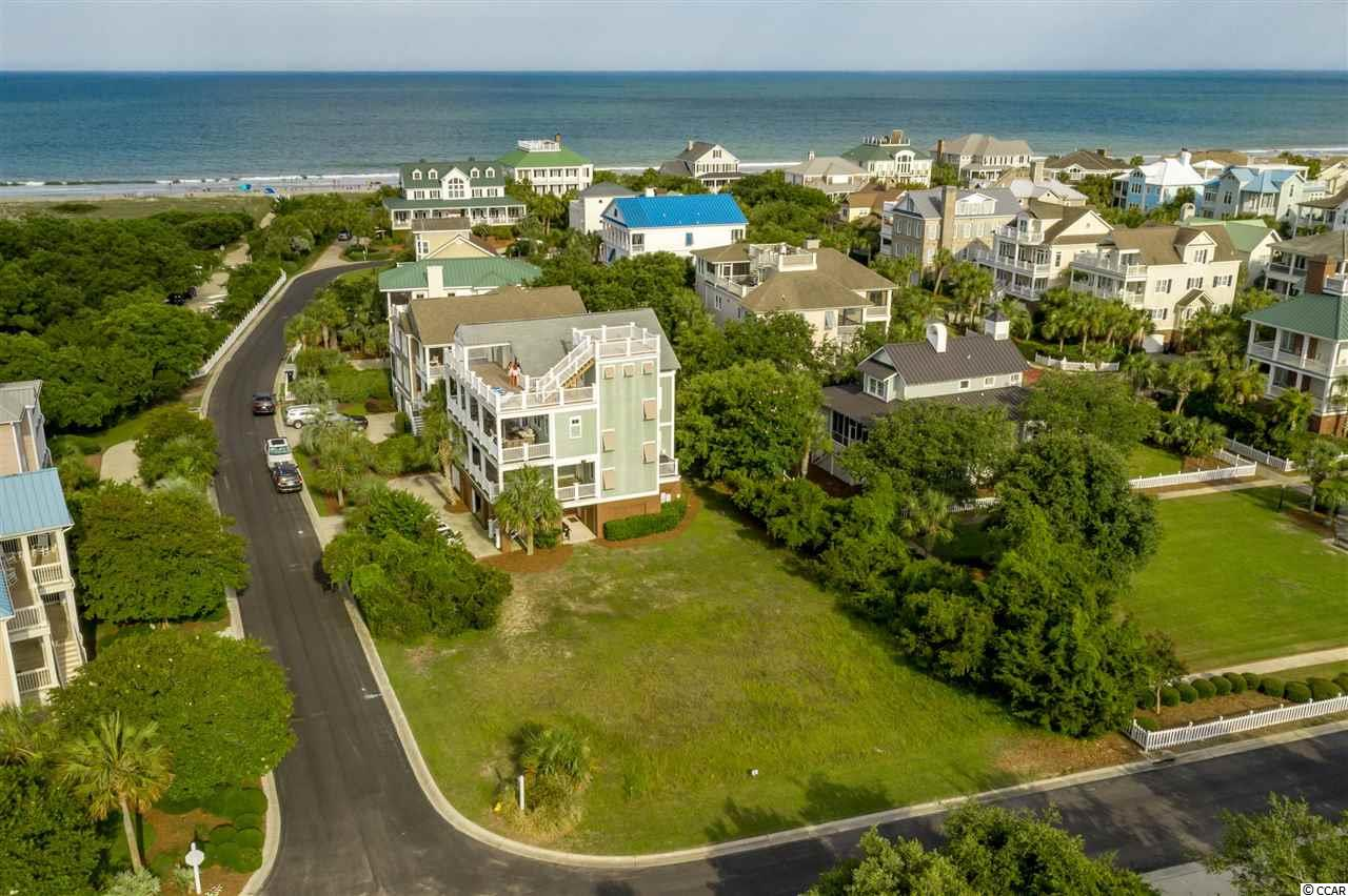DeBordieu Colony - Lot 14 Ocean Park Loop is situated about 200 yards from the north end of beautiful DeBordieu Beach. This open, corner lot offers spectacular sunset views to the west and if you build high enough, a roof top deck can provide ocean and marsh views too! Ocean Park at DeBordieu is a charming and popular neighborhood filled with Lowcountry Homes and Victorian Cottages. The neighborhood features a private beach access with boardwalk, bath houses, two croquet lawns with a band stand/gazebo between. This near beach lot is ready to build and has been cleared and recently surveyed. Lot 14 Ocean Park Loop can provide your new home with either a DeBordieu Blvd. or an Ocean Park Loop address. DeBordieu Colony is an oceanfront community located about an hour north of Charleston, South Carolina featuring private golf and tennis, saltwater creek access to the ocean, a 24/7 manned security gate, and luxury homes surround by hundreds of acres of wildlife preserves. People who have been here say there will never again be a place quite like DeBordieu Colony. Come see for yourself.