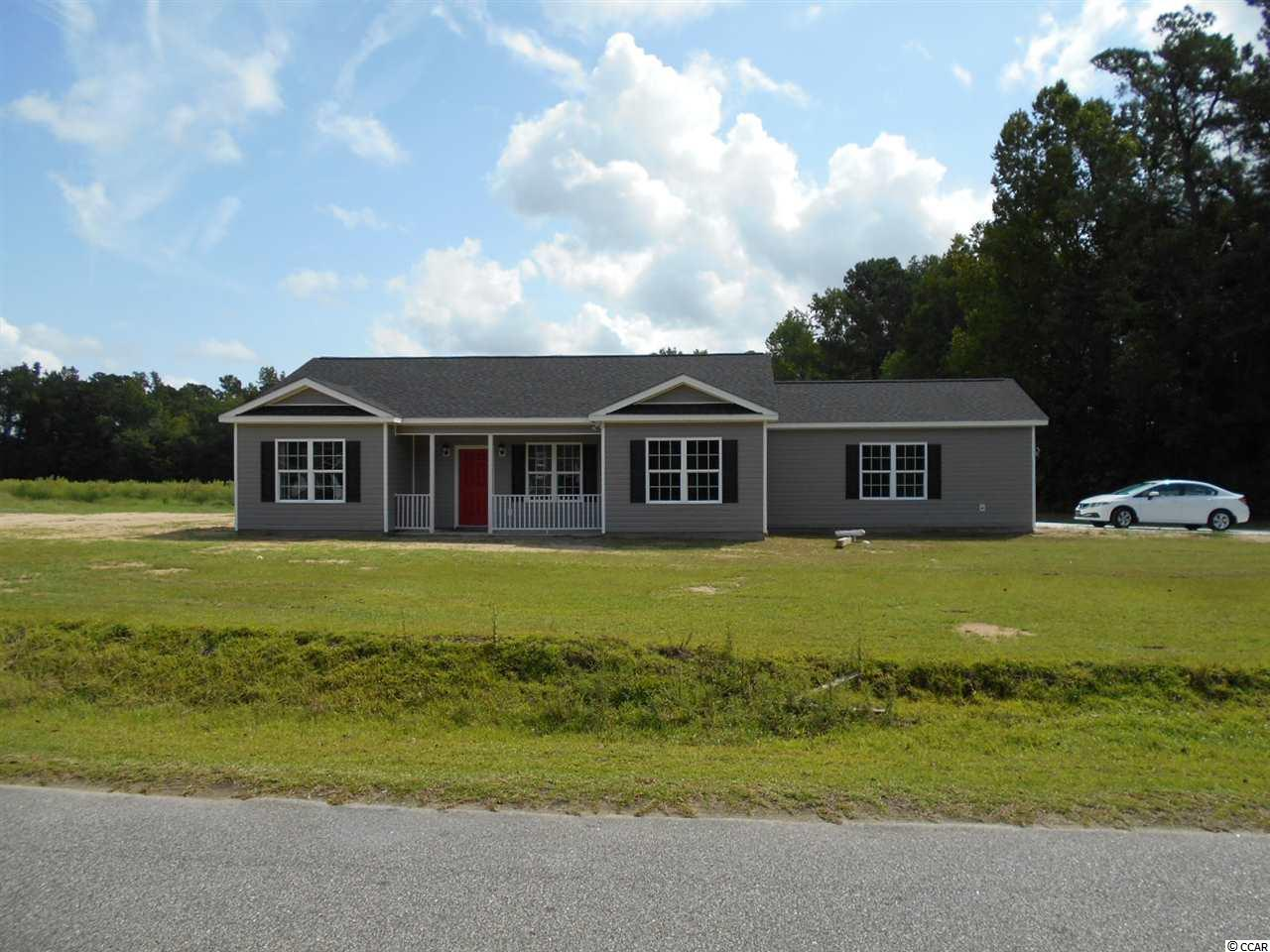Wow!  Brand new home on a .67 acres out in the country but only a short drive to the beach.  No HOA, beautiful , private country setting.  Open, airy floorplan with lots of windows.  Smooth ceilings, fans in every room , recessed lights, stainless appliances.  There is a covered front porch , a side load 2 car garage and a beautiful private back yard! SELLER SAYS MAKE A OFFER!!
