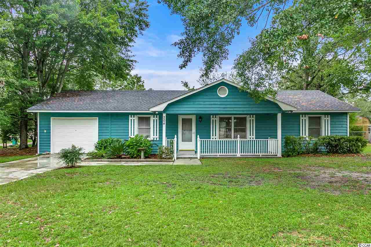 This traditional home features fresh paint, new floors and a new roof! It's move in ready condition is a bonus in addition to it's location and charm. The  open area living space offers a split bedroom floor plan. The master suite boasts of a jacuzzi tub. It also has a one car garage as well as a shed within in's fenced in yard. It's mature landscaping offers plenty of shade to sit out on the front porch and enjoy the summer's breeze. This home is also already equipped with an alarm system and a few other upgrades! Close to shopping, dining, CCU, Conway Hospital and of course a short drive to the Beach!
