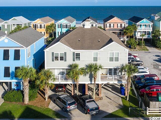 """Second Row! 15-B North Ocean Blvd is a fully furnished, 5 bedroom, 4.5 bathroom, raised beach house with ocean views, right across the street from the beach near the Surfside Pier! Known on the rental market as """"A Jolly Good PLace,"""" this 2432 Htd. Sq. Ft. home does not have a house next to it, on the south side, so there is abundant light! Located very close to the Surfside Pier, you'll be in walking distance of some of the best restaurants on the Grand Strand! Enjoy the ocean breezes and ocean views from the two covered porches. The spacious, open floorplan provides plenty of room for friends and family to gather. There are two master suites, one on the main floor, and the other upstairs with its private covered porch with a views of the ocean. There are three other guest rooms, one with a private bath, and two that share a bath. Other features of 15-B North Ocean Blvd include: New sliding glass doors and hurricane resistant windows, street side balcony off the downstairs master suite, ground level storage, covered parking for cars, golf cart, or boat, low maintenance vinyl siding, laundry room, and plenty of owners closets.  A jolly good time will be had by all when you make """"A Jolly Good Place"""" your home."""