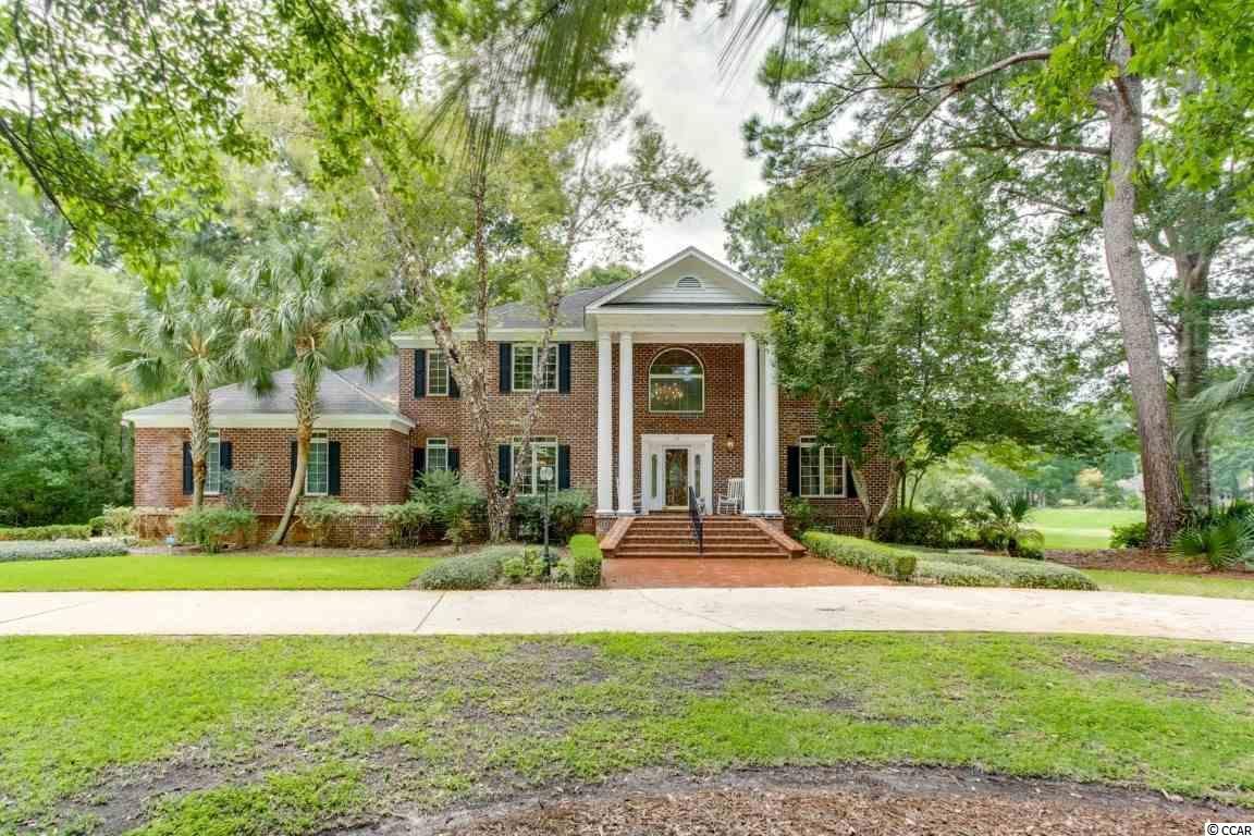 Stately colonial on choice lot in gated Pawleys Plantation. Perfectly situated this home enjoys golf course green and fairway views on one side and wooded privacy with no neighboring homes on the other. Circular drive welcomes guest and adds to curb appeal. Inside this large four bedroom four bath home offers a guest room and bath, formal dining, billiards room, great room, and kitchen with Carolina room views all on first floor. Master suite complete with fireplace and private porch overlooking the green and just down the hall two additional rooms each with full baths and walk in closets on the second floor. Roomy oversized garage, large laundry, two decks and screened porches are only some of the additional features this home has to share.