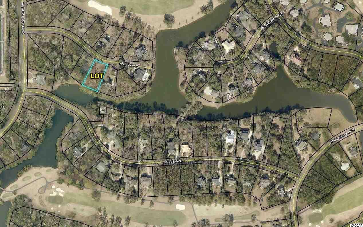 Build your dream home and golf cart to the beach! A great lot for new construction on quiet Jutland Ln. in Debordieu. This lot has an open view over a pond thru to partial golf course view.  Debordieu is a private golf cart friendly beach community.  Beautiful golf course, tennis courts, pools, walking/biking paths, on site dining, boat ramp access to North Inlet.