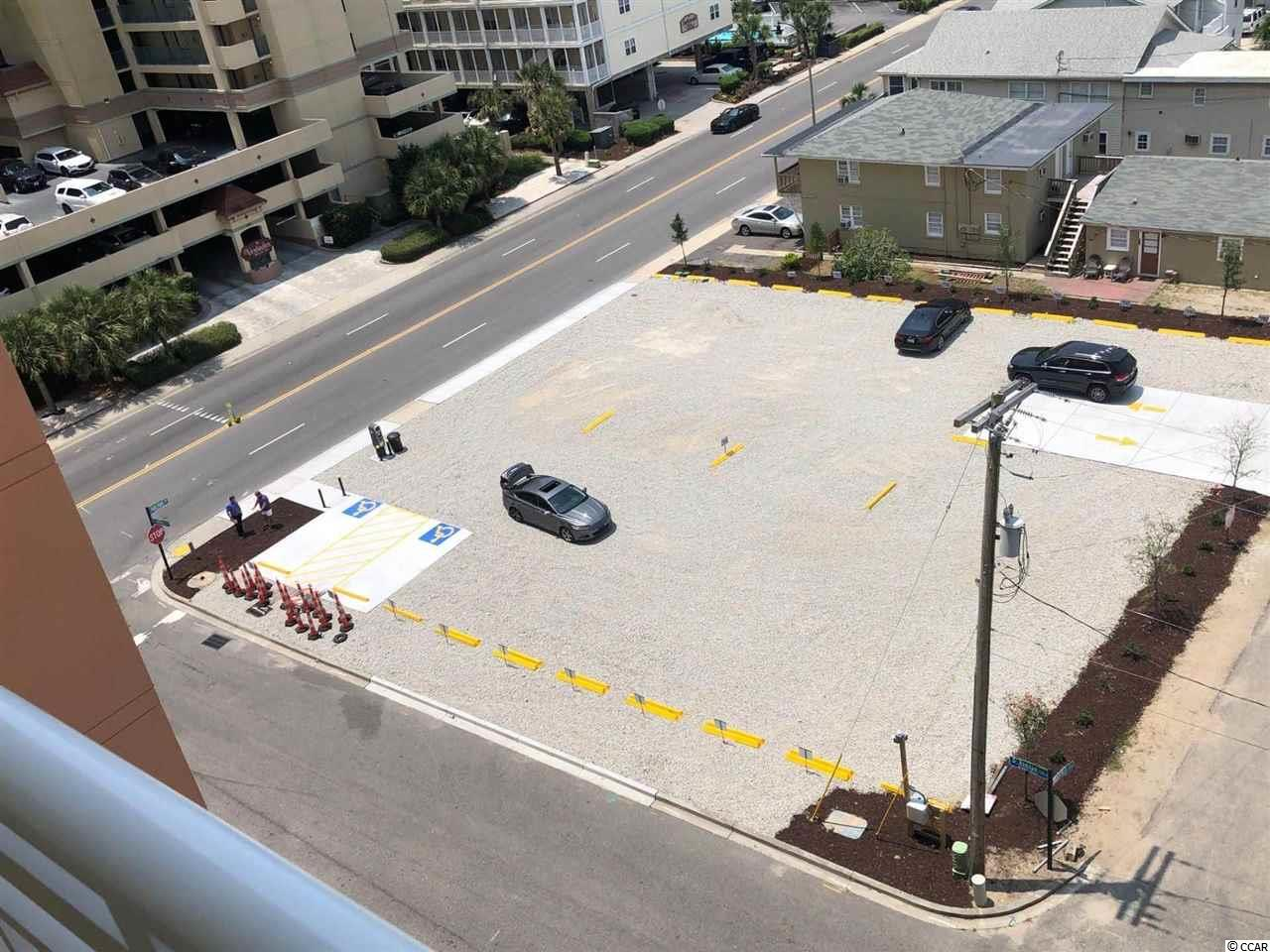 Rare opportunity to purchase a (PAY) Parking Lot  with 30 Parking spots in North Myrtle Beach across from the Wyndham. If you are looking for land to build  You can build  multi-family or single family. this lot is large enough you can divide it in to two lots.