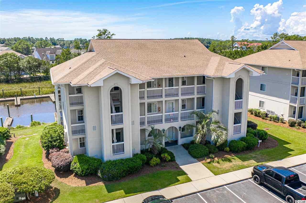 Waterway, Golf, Beach....so much to see and from which to choose! This beautiful condo has terrific views of the waterway, is in walking distance of the Eastport Golf Course, and is just a few minutes to Cherry Gove Beaches! From your corner balcony, enjoy your ever changing views of the waterway and marsh!  With upgraded appliances, tile flooring, and a brand new HVAC and hot water heater, you can enjoy your home without worrying about maintenance issues!  Enjoy the Spinnaker Cove pool or the Eastport pool - you have a choice!  And, Little River is home of the Blue Crab Festival, has great fishing, and, if you like to gamble, the gambling boats leave from the marina just a couple of miles away! You are within minutes of great shopping and dining in North Myrtle Beach! Don't wait to schedule your tour of this beautiful 2 bedroom condo!