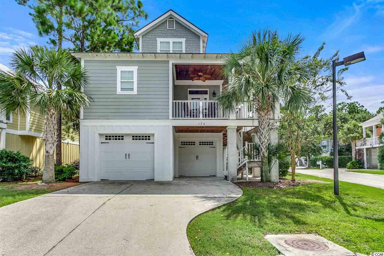 Amazing opportunity to purchase this 4bd/4.5bth Raised Beach Style Home with private elevator located in the secluded gated community of The Bays at Litchfield ! 176 Natures View Circle is being offered furnished and is ideally situated on a corner lot in the community.  Kitchen features include stainless steel appliances, breakfast bar, and has an open concept to the living area for entertainment. Gorgeous Pine flooring is featured throughout the main level of the home. Elevator access makes it easy to carry up groceries and more accommodating to get to each floor level. Large porches to relax and sit back in the rocking chairs to enjoy those summer evenings with your favorite beverage. The Bays at Litchfield is a 50 Homesite gated community that features walking trails, fishing in the common area natural protected bay, community pool, and clubhouse. If you are a buyer looking for little outside maintenance, no worries, lawn maintenance and irrigation are included in the low monthly HOA dues. This would make a perfect vacation home or primary residence for a family. Just a short golf cart ride to access Litchfield beach, restaurants, yoga studio, shopping, and fitness gym. Only 30 minutes to the Myrtle Beach International Airport, 20 minutes to Historic Georgetown, and a day trip to Charleston. Call today for a showing !