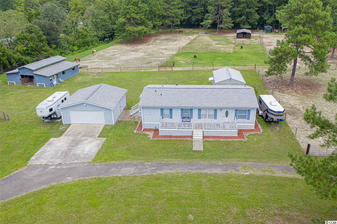 Located  conveniently off of 905 and just 5 minutes from downtown Conway you can have the best of both worlds. The opening of international drive to HWY 90 truly makes this location amazing. This is a unique opportunity to have all the comforts of home, your horses, and animals and still just be minutes from town, and just 30 minutes from the beach! This farm features a 3 bedroom 2 bathroom meticulously kept home with all new carpets. The roofs and gutters on all the structures are also brand-new. The barn is as clean as the house! All the horse stalls are matted with fans, hay mangers, and electricity to each stall. The aisle way is done in pavers. There is a tack and feed area as well. With five horse pastures multiple hay and storage sheds your animals are sure to be happy. Ask your agent about farm items to convey with property!