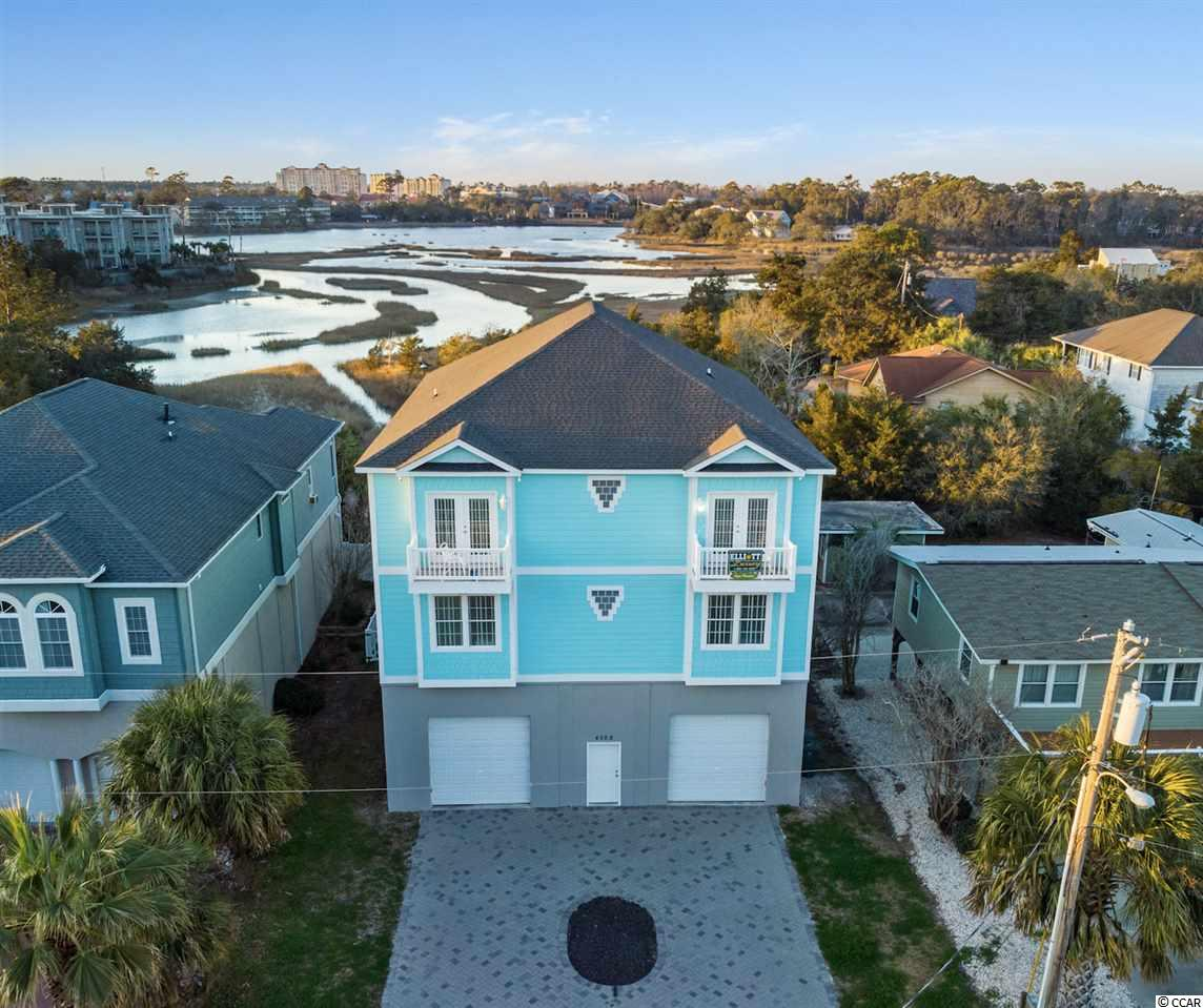 """Just Reduced!! Great investment opportunity with 7 consecutive years of large rental income. This home was built with maximum occupancy in mind. Enjoy the quiet marsh setting while being 1 block, a quick walk or golf cart ride from the beach. This 7 Bedroom, 6 Bath, features 1100 sqft of covered porches, outdoor pool and elevator. The rental opportunity is abundant  while the new owner can book repeat guests for this 7 bedroom/28 guest home. The well appointed kitchen includes granite counter tops, 2 refrigerators, 2 ovens, 2 dishwashers, 2 microwaves, 6 burner flat top range. and plenty of counter top and bar stools. There is easy to clean 18"""" Porcelain floor tile throughout all rooms except bedrooms. Tubs are tiled and commercial grade carpet in all bedrooms.Game-room with pool table and multicade and megatouchvideo machines and Granite wet-bar is enough to keep everyone entertained. Outside you will find a great swimming pool, grill, vinyl fenced in back yard, and an aluminum spiral staircase from ground to both decks. Handicap bathroom meets ADA guidelines and roll-in-shower. Building upgraded and took some of Miami Dade County Specs as a guild to elevate the quality/safety of the home. Exceeded amount of concrete and #8 Rebar used to set the foundation. 39 Pillars going 14 foot down. Roof & Walls with Zip System, Advantech sub-flooring. Hardiplank siding, Stucco enclosed garage walls, parking for 3 cars/boat garage w/(2) 10 x 12 foot garage doors. Easily 6-car parking on the outside paver driveway.Great return on your investment. Rental history for the past 5 years can be provided."""