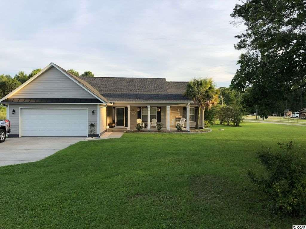 Beautiful, fully updated home on 3.27 acres located on the Intracoastal Waterway! Land like this is so hard to find especially with a move in ready home! This house has so many great upgrades like a spa designed bathroom, two huge built in master closets, mudroom, vaulted ceilings, granite throughout, hardwood floors, a separate office & a large shop in the back yard! Schedule your private showing today!