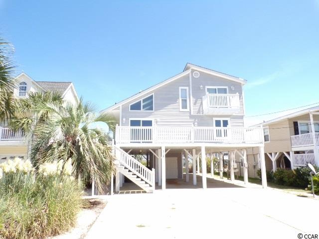 Beautiful home on the channel. This 4 bedroom, 3 bath home sits on the channel in the prestigious area of Cherry Grove. From the deck on the roof you can view for miles around or enjoy the fireworks shows that are put on by the pier. This spacious home with it's vaulted ceilings is great for entertainment and the well designed floor plan is great for guest.  More pictures coming soon.