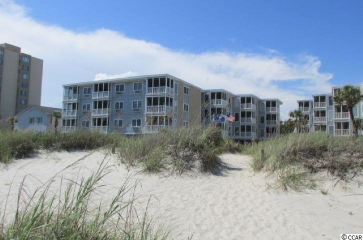 """Looking for a Completely Updated Ocean Front Condo that you can just move your clothes into and start enjoying the beach life?  Well here it is! As you enter the unit, to your right is a door that opens into a stack washer and dryer.  Continue walking and to your right is the kitchen, which features new glass top stove, plus oven and microwave.  New refrigerator to your right, new built in cabinets and it is completely wrapped with granite counter tops.  All new pots, dishes, silverware remain in the unit.  Looking out from the kitchen is the dining room table and chairs which are new.  The living area features comfy furniture that makes you want to stay and just relax. Living area leads out to the screen porch with no obstructive view of the ocean.  Relax at night on the porch with line lights above you and enjoy the ocean breezes.  Glass doors leading to porch are new.  The Master bedroom has ocean front view, new bedroom furniture and new upgraded bathroom.  Did I mention new TV's in every room?  Floors are waterproof laminated with lifetime warranty.  Overall view of this unit will bring up the question of """"who's the decorator?""""  Manager lives on site. This one is a Must See!  Square footage is approximate and not guaranteed.  Buyer is responsible for verification."""