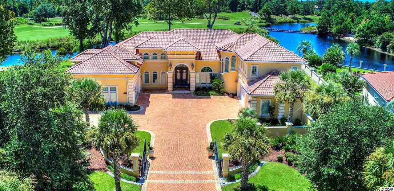 Luxurious Myrtle Beach Living!! Are you looking for a Majestic Estate with World Class Amenities? Look No Further!! This estate is nestled within the Premier Guard Gated Waterway Community of the Grande Dunes. From the time you travel over the Mediterranean Style Bridge to the main entrance of the Grande Dunes you are immediately taken aback by the views over the Intercoastal Waterway and the beauty of the community. Grande Dunes is a 2200 acre property with Lush Landscape, Majestic Estates, and Unsurpassed Amenities which include a Private Par-71 Championship Golf Course, 126-slip Marina, Tennis, and the Grande Dunes Ocean Club. Whether your sunbathing by the pool at the Ocean Club, enjoying the private beach access, indulging yourself with the gourmet cuisine of the restaurant, or hosting your own private function the Ocean Club will be the highlight of your social life!   This LAKE FRONT GOLF COURSE VIEW Estate is an ENTERTAINERS DREAM with a Fully Equipped GOURMET KITCHEN which includes not one but THREE Half Dishwashers, a FULL SIZE Freezer & FULL SIZE Refrigerator, Thermadore Double Oven & Warming Drawer, 46 INCH Cabinets, Warming Lamps over Stove and a Butcher Block Island equipped with a Sink, Garbage Disposal, and Additional Storage! The Custom Illuminating nearly FLOOR TO CEILING WINDOWS in the Great Room give uninterrupted views of the Lake and Picturesque Golf Course. The elite WET BAR within the Great Room is stocked with its own Ice Maker, Wine Cooler, Refrigerator, and another Half Dishwasher! Equipped with an Audio System throughout the home and wired for HOME THEATER.  Buit with Interior and Exterior STEEL STUD FRAMING ideal for high-wind hurricane prone regions. Steel framed homes are FIRE RESISTANT, ENERGY EFFICIENT, MOLD AND TERMITE RESISTANT! The Hurricane Resistant Windows and Front Door Motorized Pull Down Protection Panel add to the safety of the home as does a Video Surveillance Security System and Walk-In Hurricane/Safe Room. Two Story HIS 