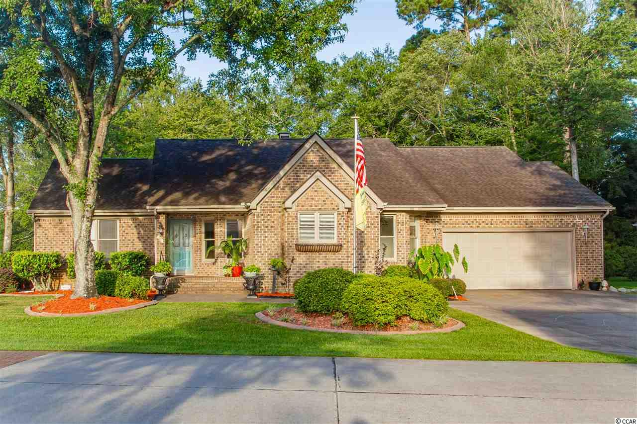 You won't want to pass up this all-brick single level home on a beautifully landscaped corner lot in the custom home section of The Lakes subdivision.  Enter to your tiled foyer leading to the large great room with vaulted ceilings, a fireplace and custom bookcases. New laminate plank flooring has been installed in the dining room, hallways, great room and Carolina room.  The kitchen, also with plank flooring, has painted cabinets, a work island, a large pantry and breakfast nook. Dining room has trey ceiling and corner built-in glass shelf enclosures. Walls, doors, and trim have been freshly painted. There are several extra storage closets throughout and a walk-in utility room. Enjoy privacy with this split bedroom floor plan.  The spacious master bedroom has a trey ceiling and sliding doors to a deck. The master bath includes a double vanity, whirlpool tub, separate shower and large walk-in closet. The Carolina room opens to a deck which also wraps around to the master bedroom deck.  Both overlook a beautifully landscaped back yard with irrigation to help maintain. The double garage has storage above.  Home is vacant and move-in ready.  Square footage is approximate, subject to verification by buyer.