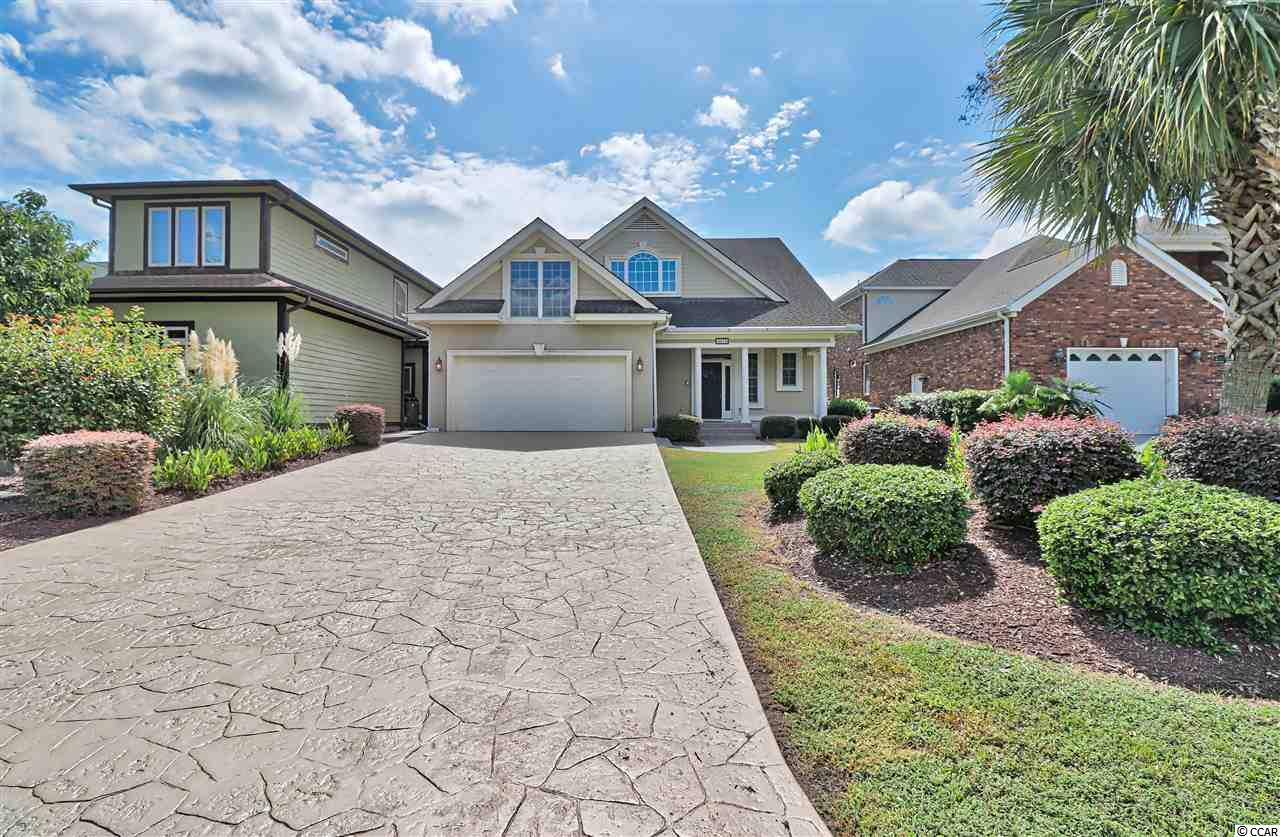 If waterway living is what you are looking for, don't miss this beautiful home.  This is a boater's dream to own this large 4 bedroom/3.5 bath home that sits on a deep water lot.  Master bedroom is on first floor.  There is an office on the first floor that could also be used as a 5th bedroom (or nursery).  Large kitchen and living room that opens into the huge family room with fireplace overlooking the waterway and your own private dock and outside kitchen.  Upstairs enjoy another large family room also with a fireplace with gorgeous views of the waterway and three more bedrooms.  The ocean is a short boat ride away.  Access to many activities on the waterway including shopping and dining at Barefoot Landing, jet skiing, fishing and enjoying all the beautiful nature you will find exploring the Intercoastal Waterway.  Venture out to Bird Island and Little River Inlet for lots of sports fishing and crabbing.