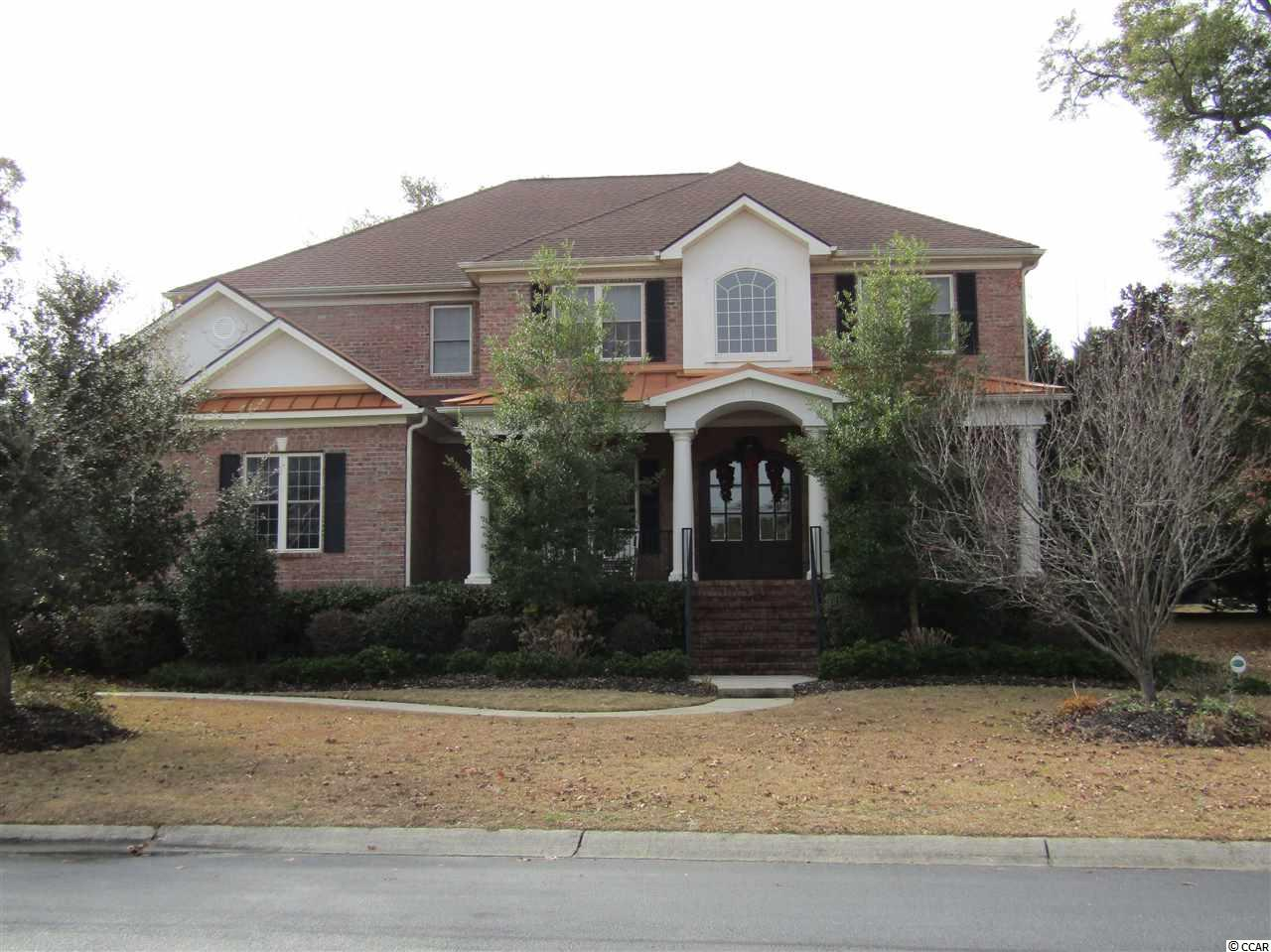 MOTIVATED SELLER!!!  Seller offering to pay one year HOA dues, Home Inspection and Offering Home Warranty!  Be prepared to say WOW when you walk into this stunning, all brick custom home in the prestigious Big Landing Plantation!  With five bedrooms, 3 full bathrooms and 2 half bathrooms and an open floor plan, this home has room to roam.  The home boasts a two story foyer and kitchen area, high quality flooring including bright, shiny hard wood, ceramic tile, custom cabinetry, crown molding throughout and many surprising architectural features like arched doorways and beveled wall corners.  As you enter the home you will see the elegant formal dining room and large office… from there you will be drawn to the spectacular gourmet kitchen with it's warm and inviting colors, stainless appliances (including two wall ovens), gas stove, granite counter tops, wraparound bar, an island with a sink and also an attached dining area with a built in desk.  Just a few steps from the kitchen is the family room featuring a fireplace and custom built in book cases.  The over sized master suite is exquisite with its tray ceiling, expansive walk-in closet and amazing master bath that features a huge garden tub, stand-alone shower and double vanities.  On the second level you will find the lofted game room which includes a spectacular Old English pub style bar area.  A draw for nights of entertaining friends and family or just kicking back and watching the big game!  The second floor also has four bedrooms and two full bathrooms.  Other home features include ceiling fans throughout, an integrated sound system, a screened porch that leads to the fenced back yard and a huge two car garage with plenty of room for storage, beach items and even a work area. Pictures do not convey how absolutely beautiful this home is!   Big Landing Plantation is a double gated waterway community that's conveniently located between the amazing beaches in Sunset Beach, NC and North Myrtle Beach, SC.  The com